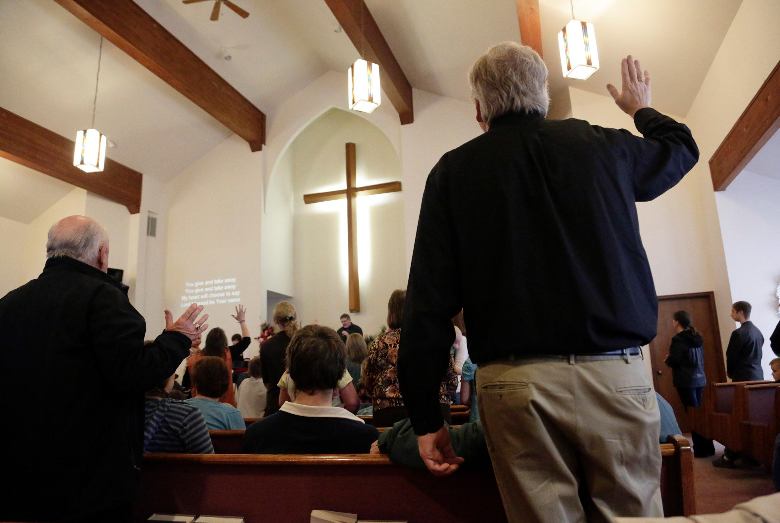 Image: People worship during service at the Glad Tidings Assembly of God church in Darrington