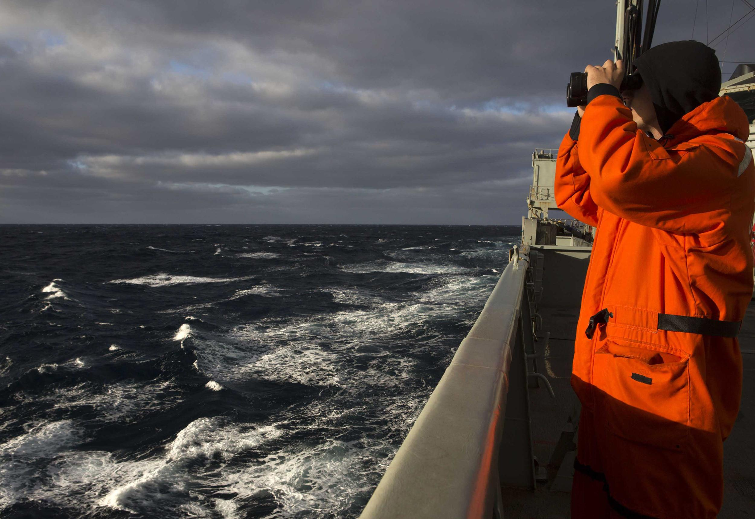Image: Able Seaman Marine Technician Matthew Oxley keeping watch onboard the HMAS Success