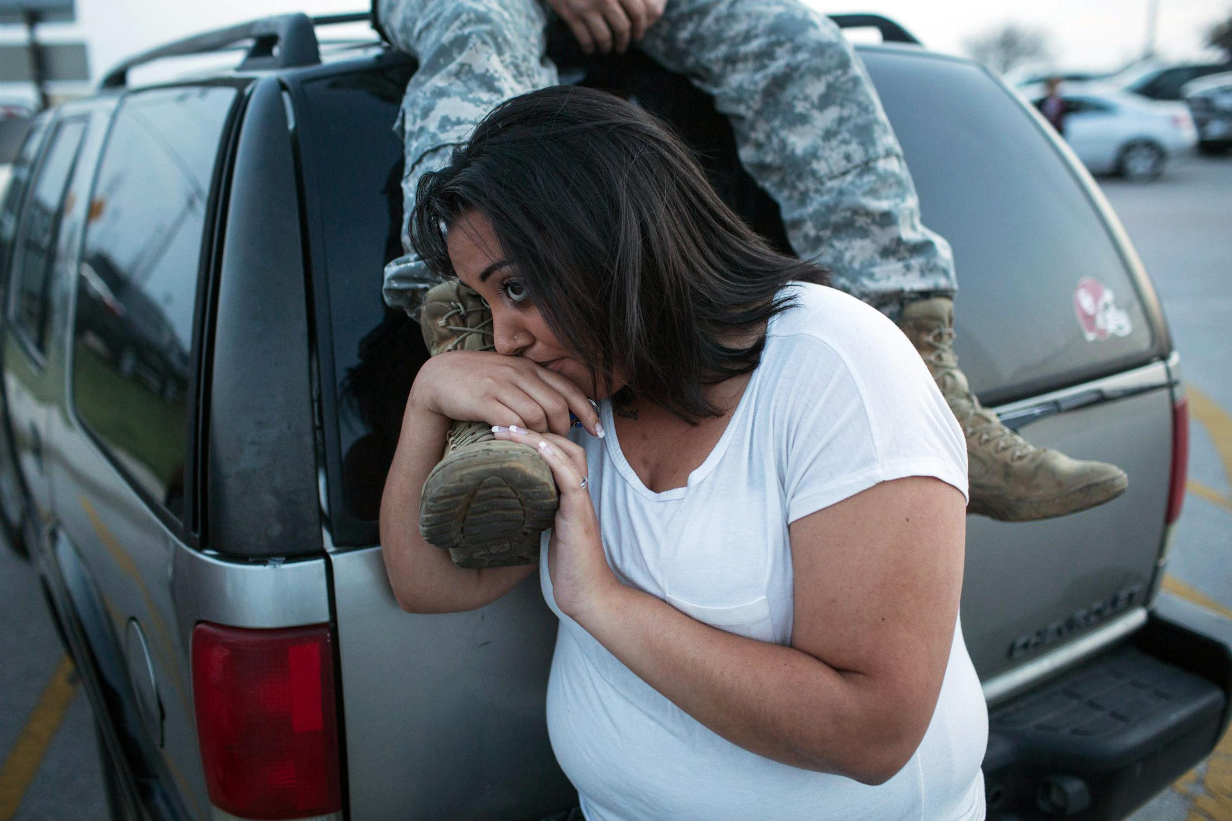 Image: Lucy Hamlin and her husband, Spc. Timothy Hamlin wait for permission to re-enter the Fort Hood military base, where they live
