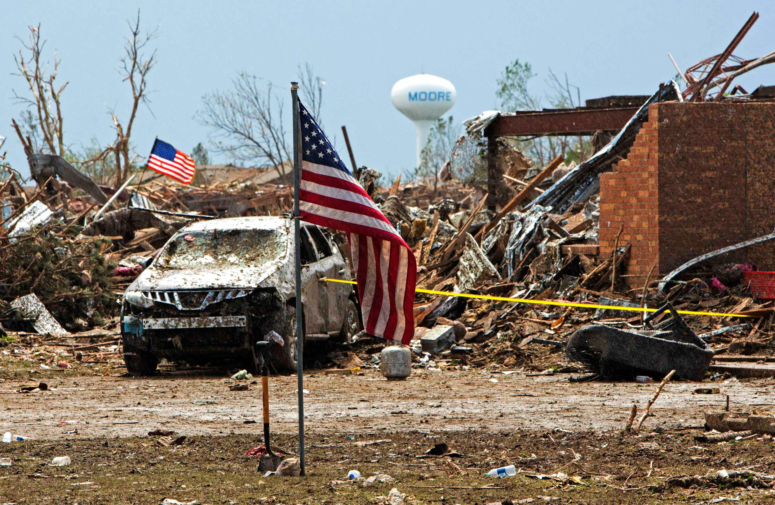Image: American flags wave over the remains of Plaza Towers Elementary school in Moore, Oklahoma