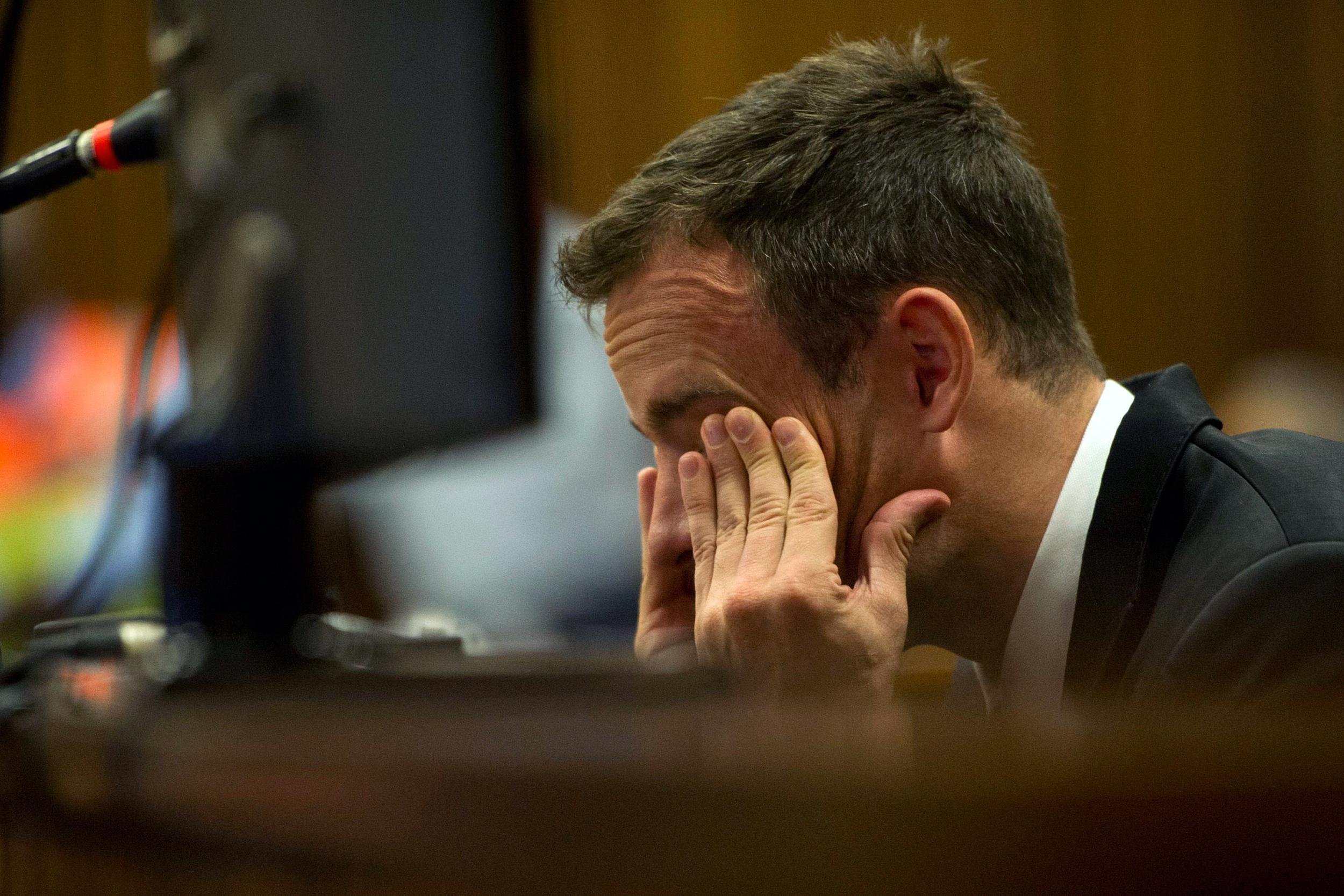 Image: Oscar Pistorius reacts during his trial at the high court in Pretoria