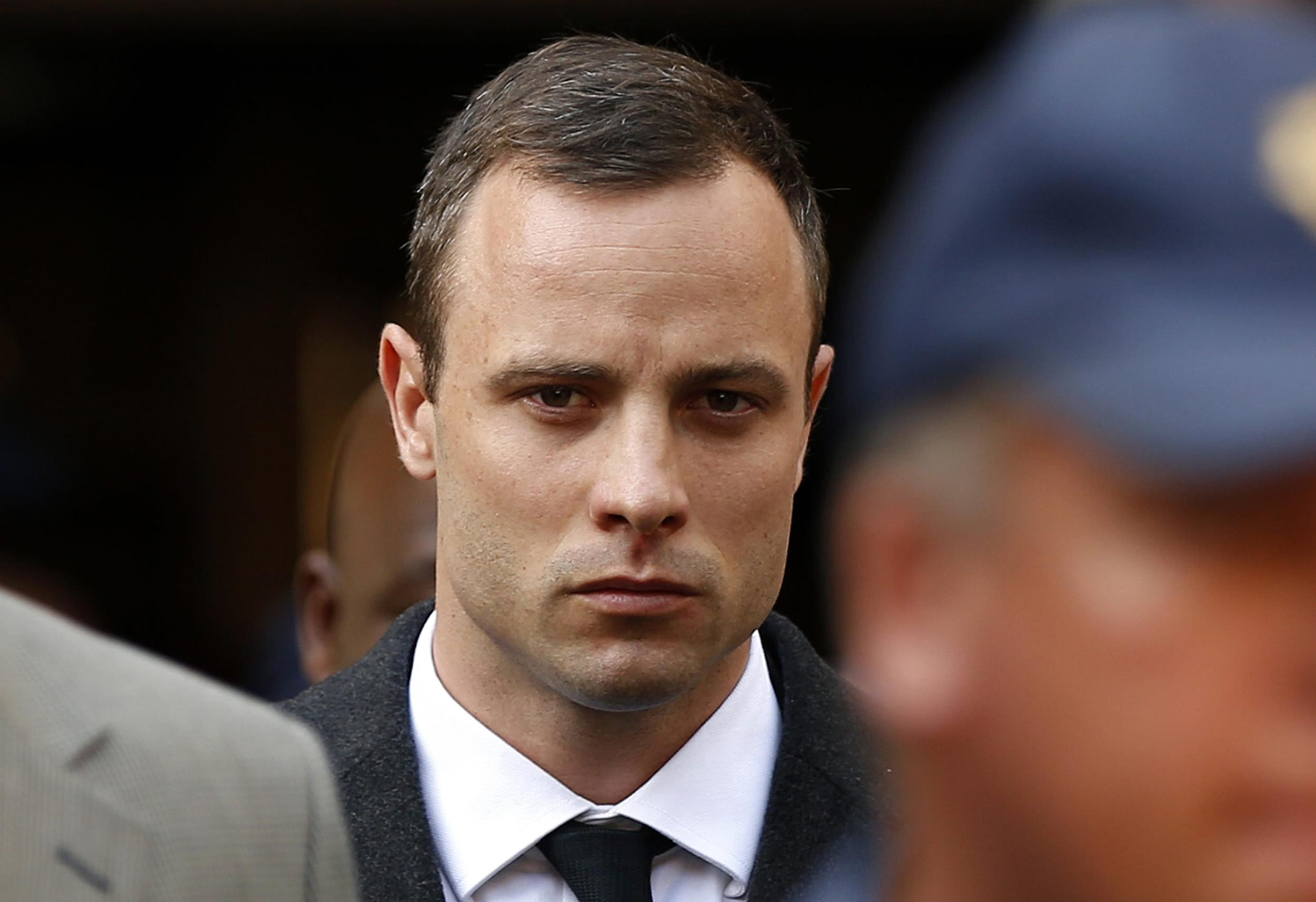 Image: Pistorius leaves after attending his trial at the high court in Pretoria