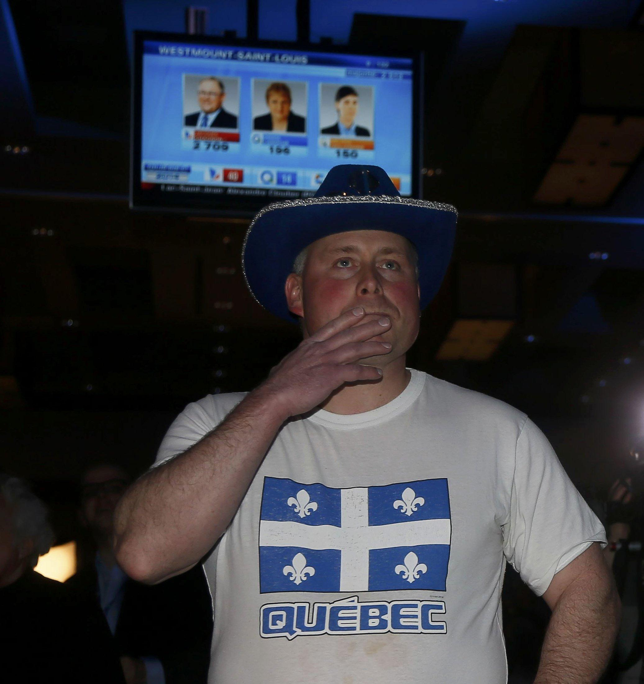 Image: A Parti Quebecois supporter watches results on Monday