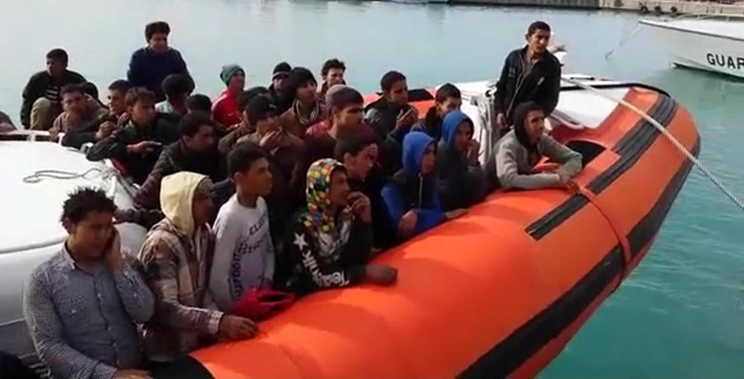 Image: Migrants rescued in the Strait of Sicily arrive in the port of Pozzallo, Sicily