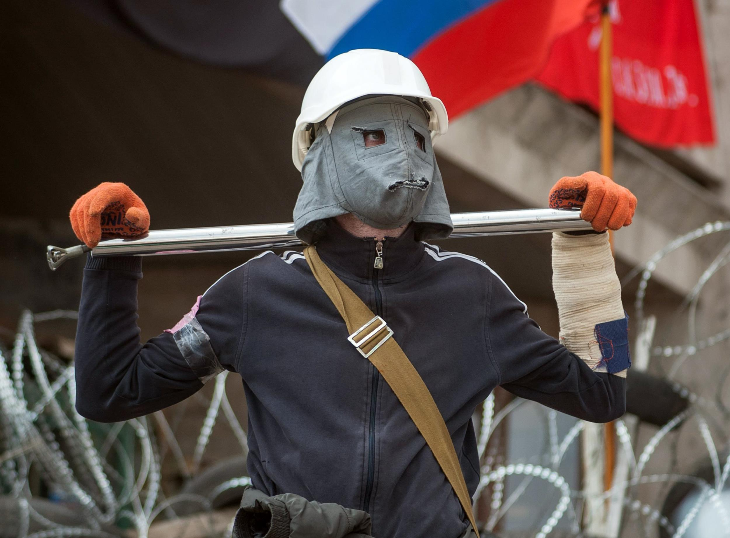 Image: A pro-Russian protester attends a rally in Donetsk.
