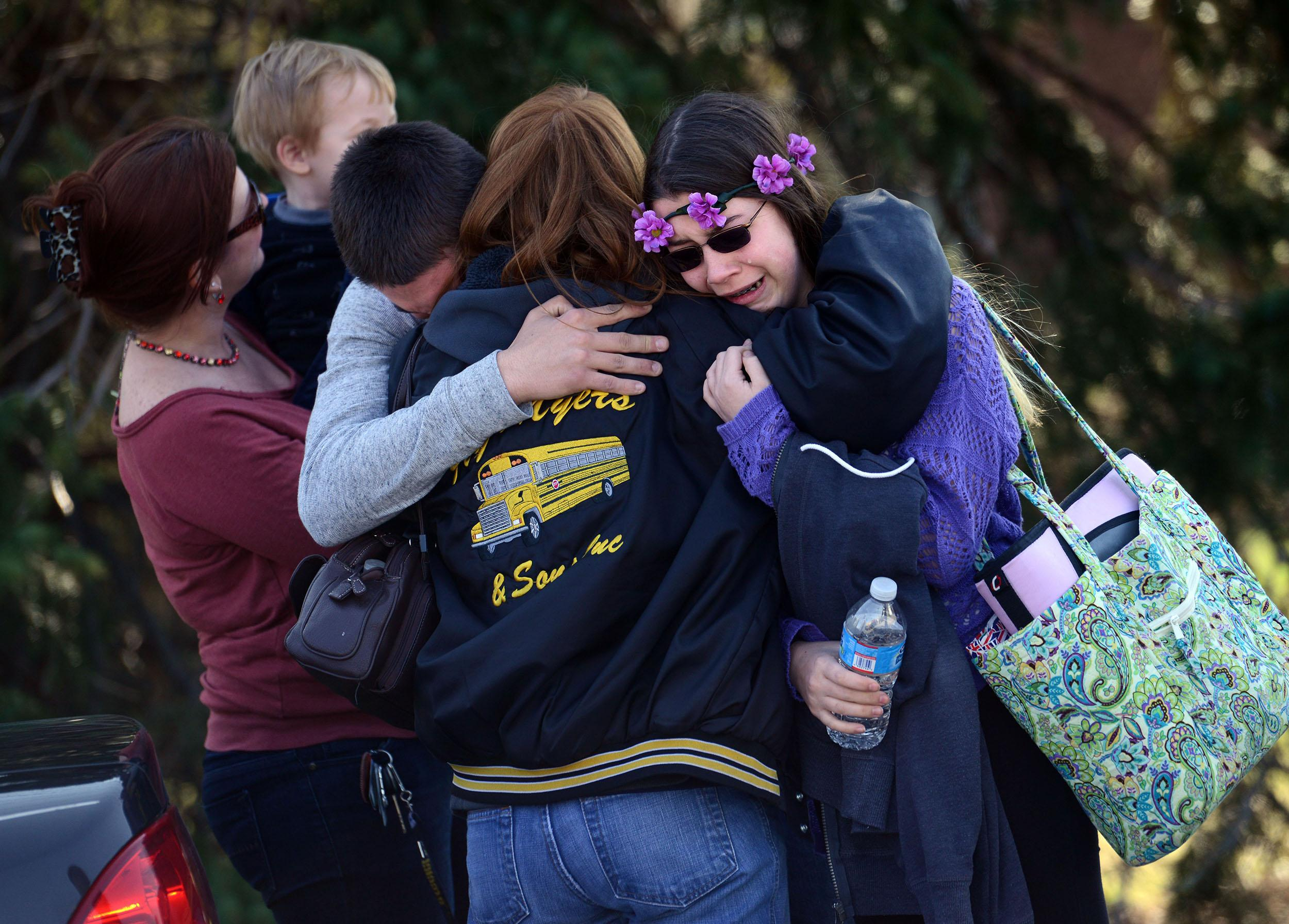 Image:Parents and students embrace along School Road near Franklin Regional High School after more than a dozen students were stabbed by a knife wielding suspect at the school