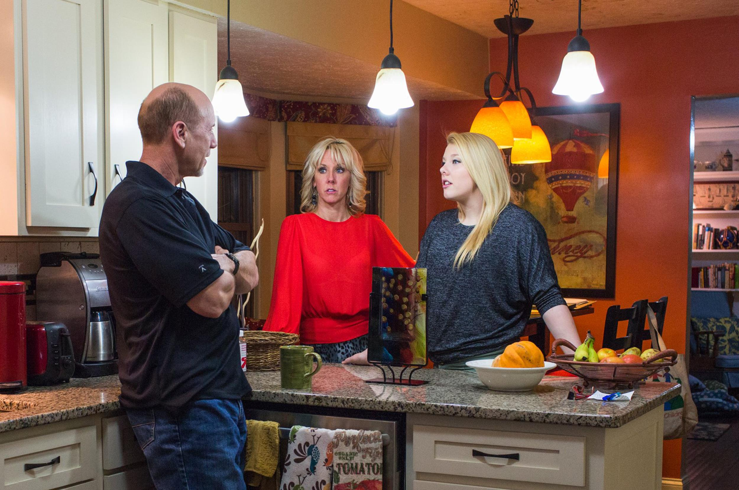 Image: Cathy Tiffany, 44, talks with daughter Autumn Selby, 16, and husband Gary Tiffany