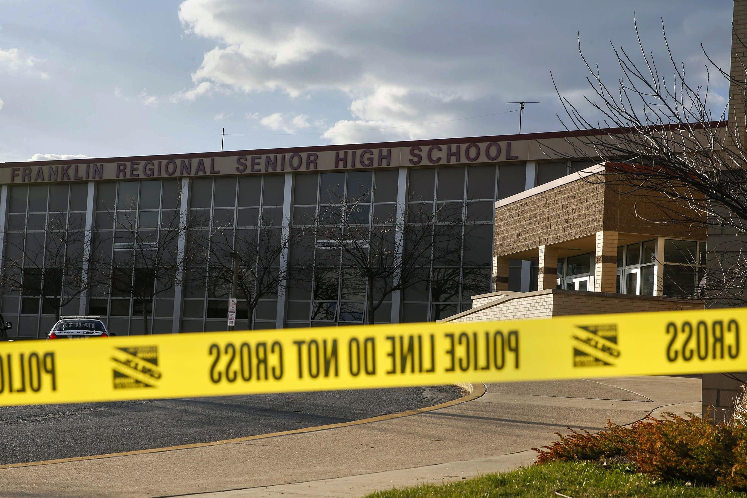 Image: Police tape is seen outside Franklin Regional High School after a series of knife attacks in Murrysville
