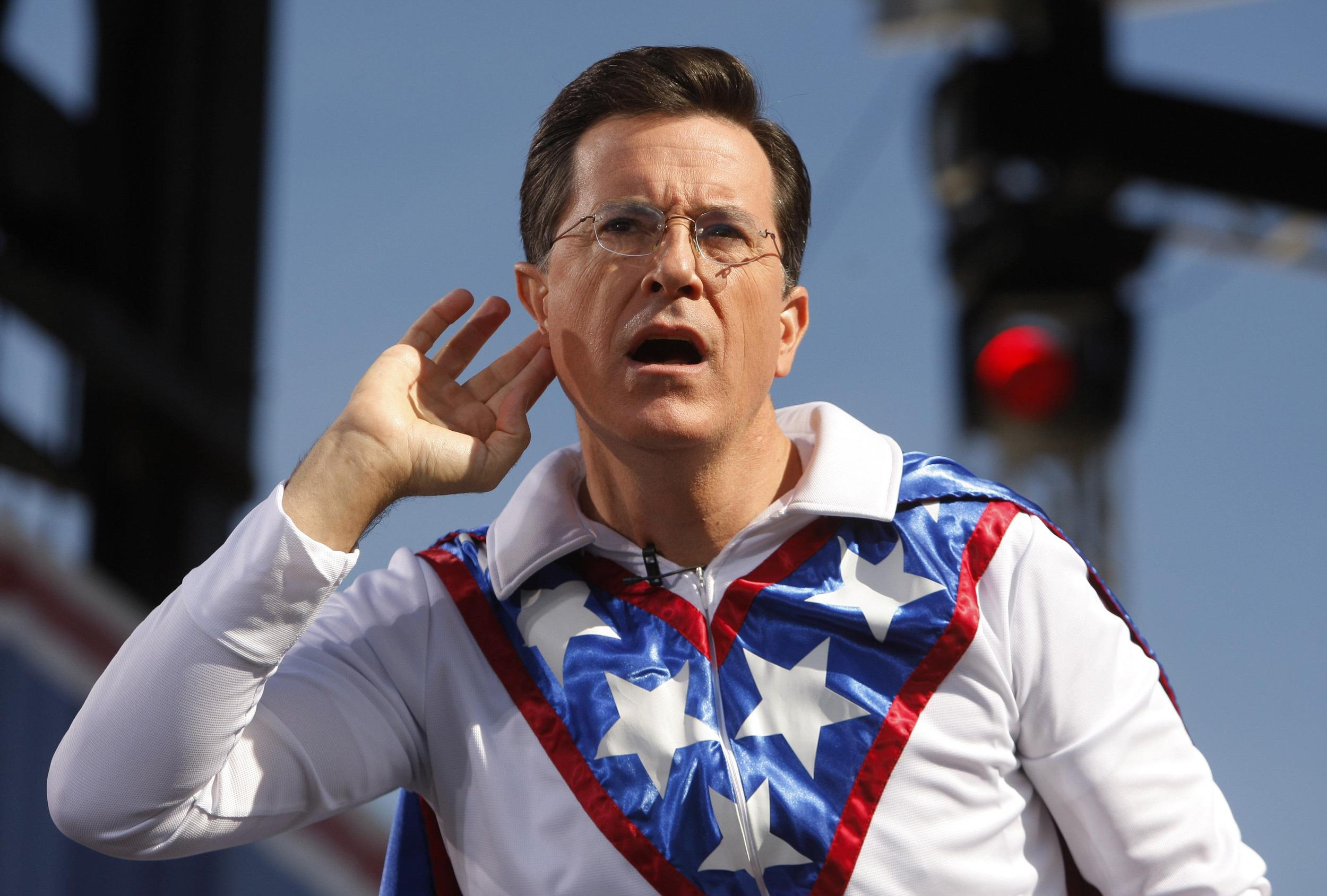 Image: File photo of Comedian Stephen Colbert gestures during the
