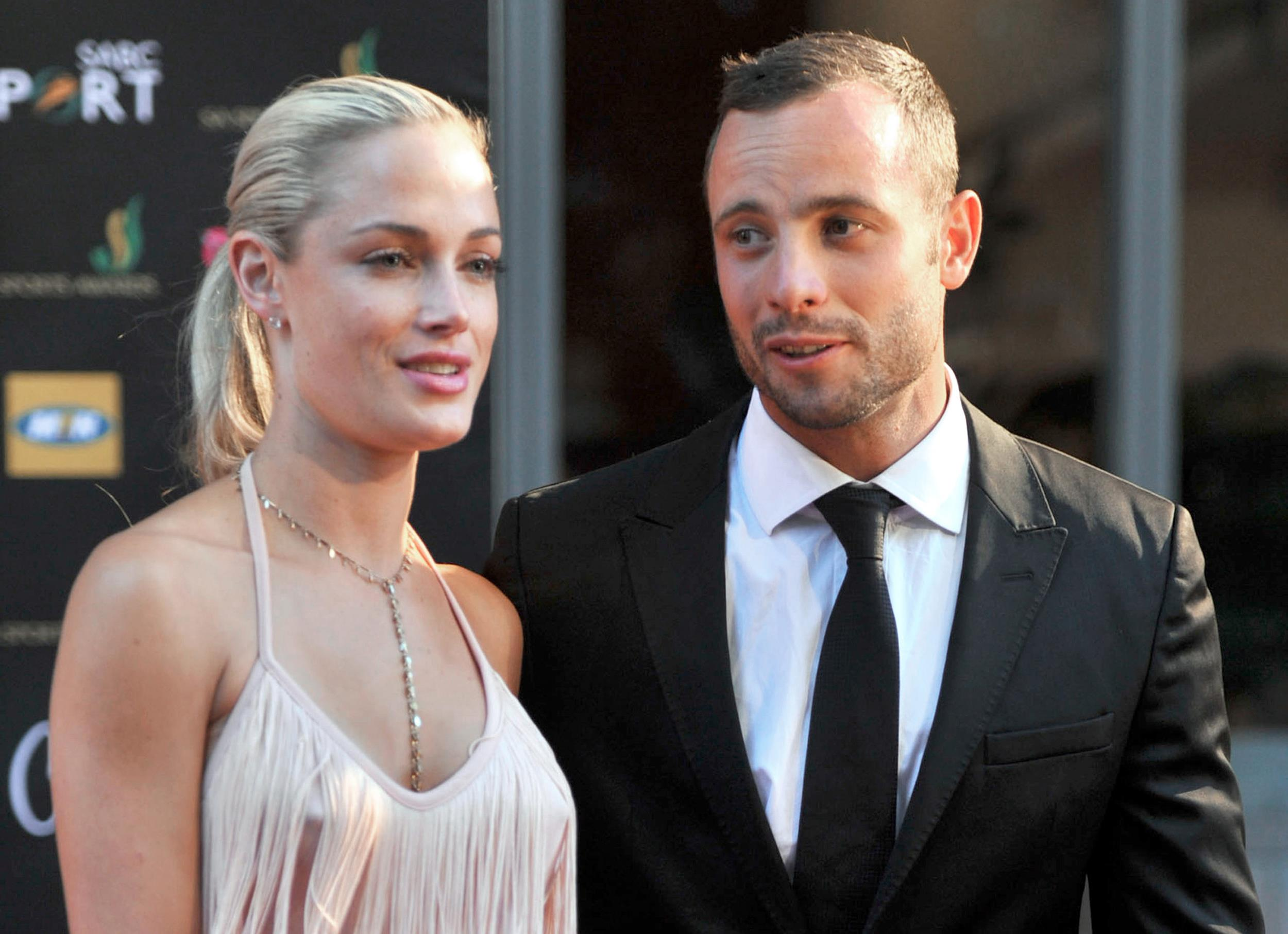 Image: South Africa's Olympic sprint star Oscar Pistorius and his model girlfriend Reeva Steenkamp