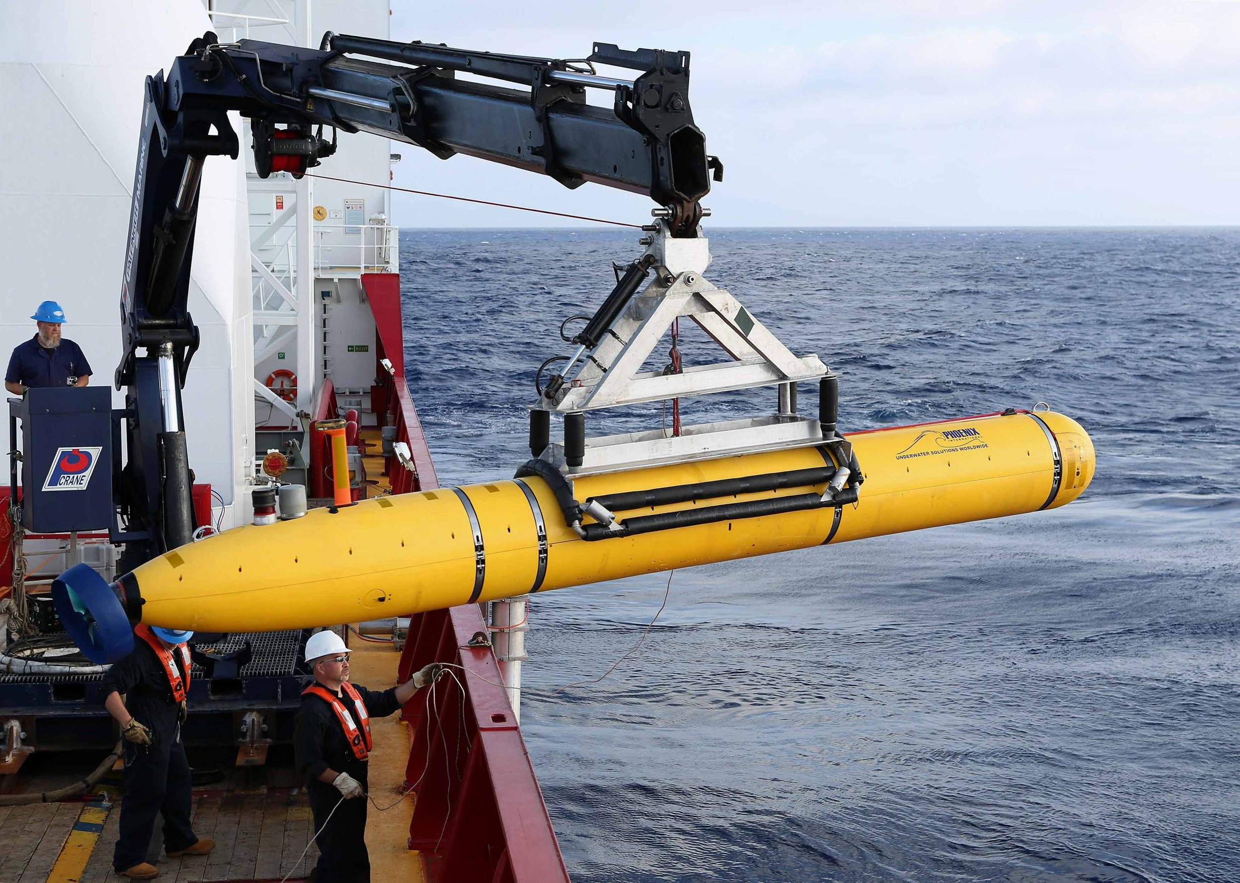 Crew aboard the Australian Defence Vessel Ocean Shield move the U.S. Navy's Bluefin-21 autonomous underwater vehicle into position