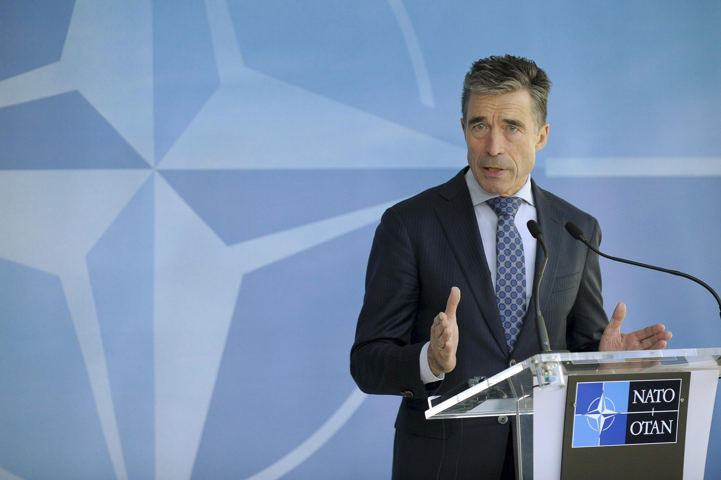 Image: NATO Secretary-General Anders Fogh Rasmussen speaks at a news conference at the Alliance's headquarters in Brussels