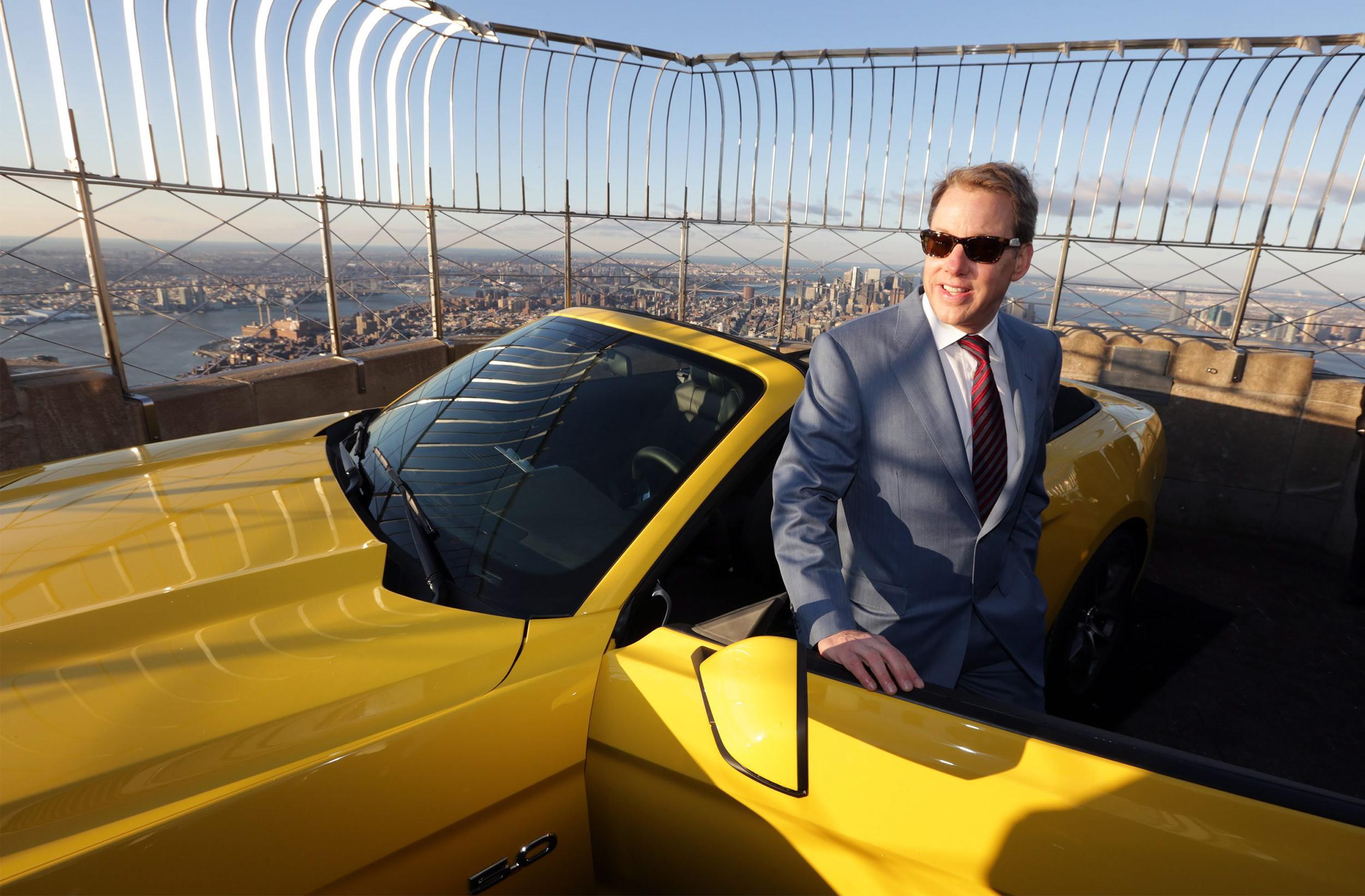 Image: Ford Motor Company Executive Chairman Bill Ford poses next to a fully assembled 2015 Mustang convertible on display after an unveiling to honor 50 years of the Ford Mustang at the Empire State Building