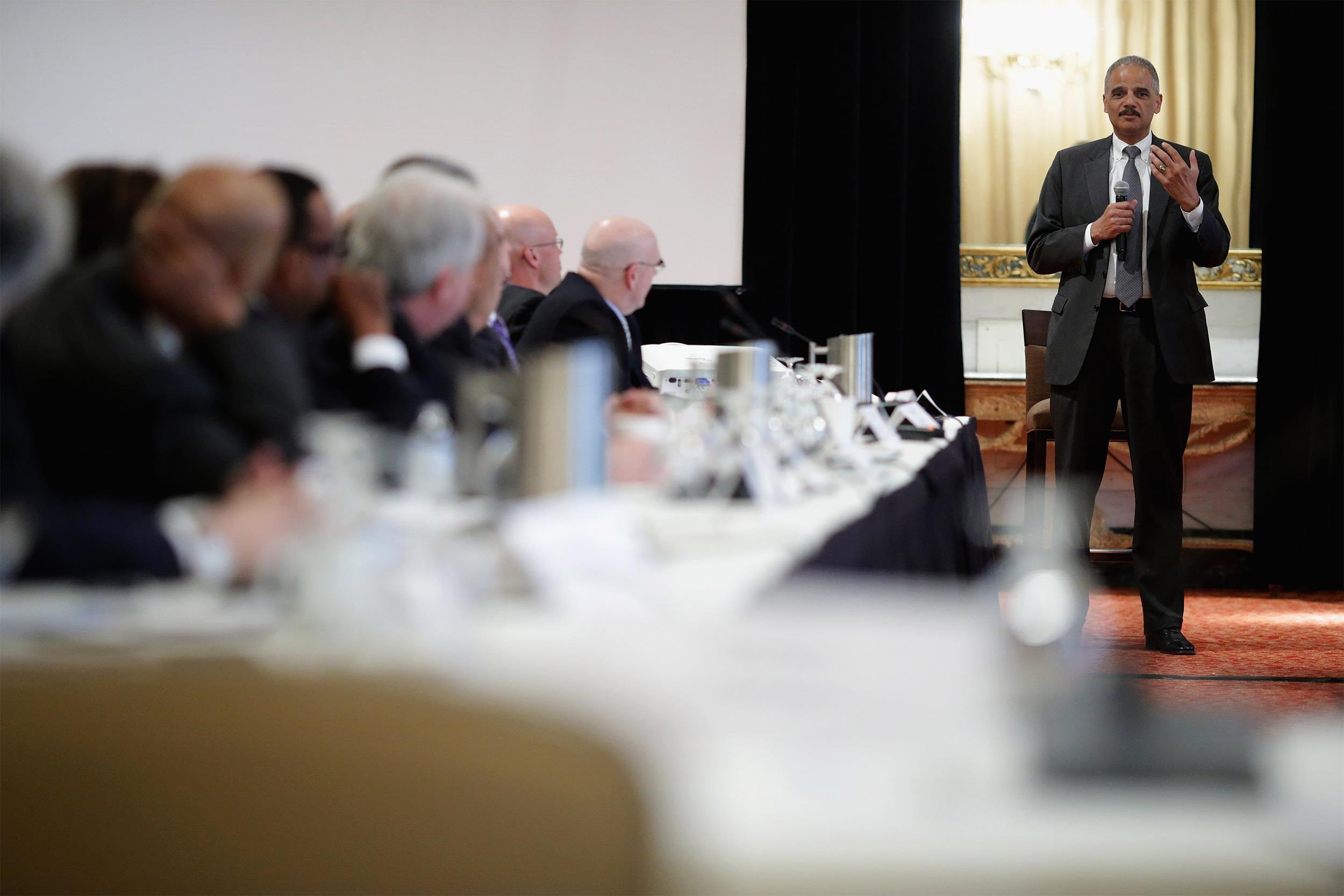 Image: United States Attorney General Eric Holder addresses the Police Executive Research Forum's National Summit at the Mayflower Hotel