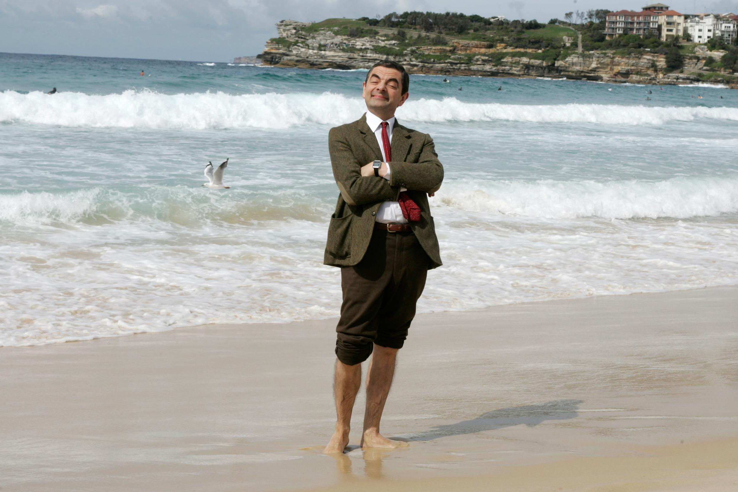 Image: British actor Rowan Atkinson plays his character Mr. Bean on an Australian beach on March 7, 2007.