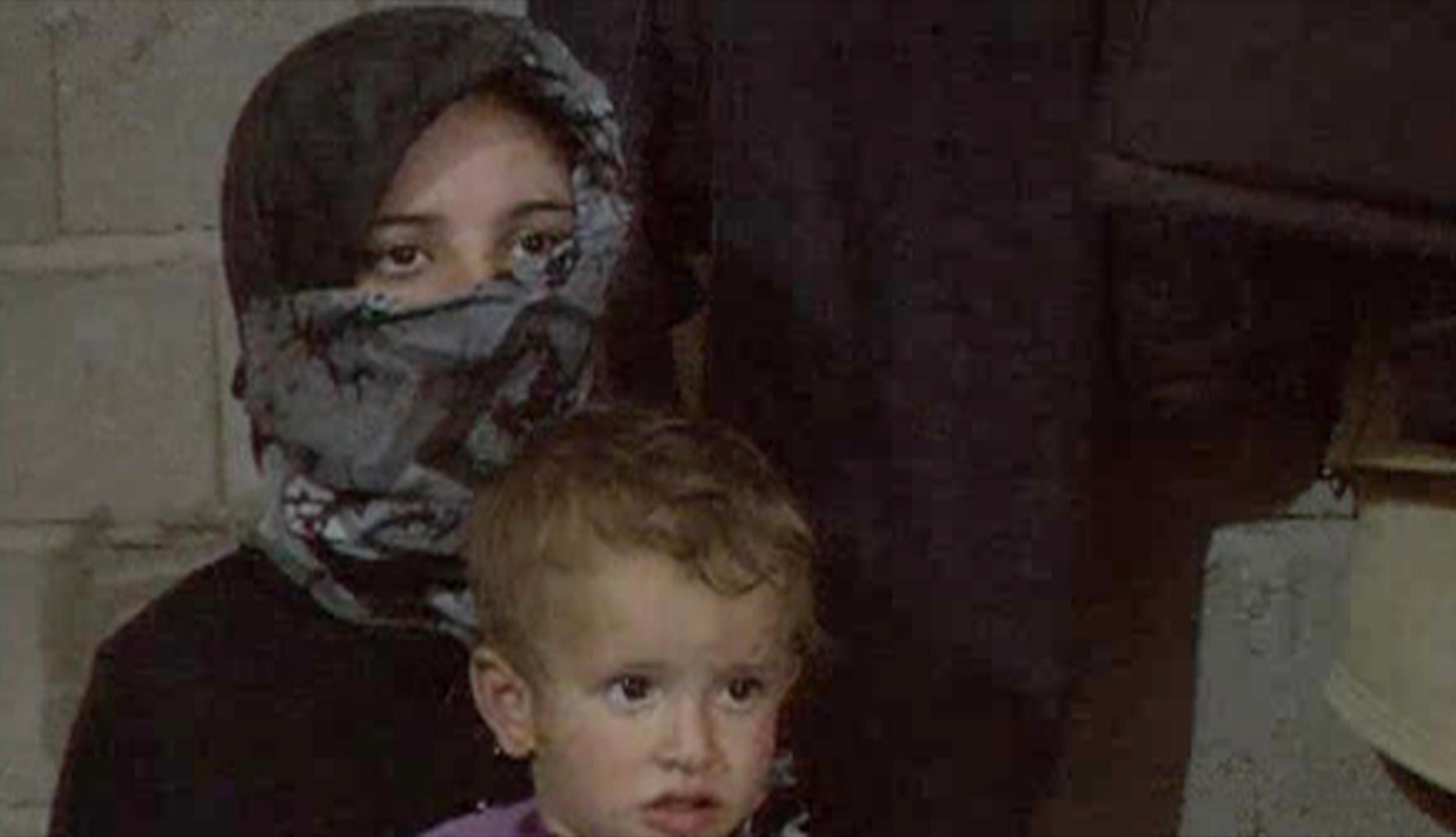 Syrian mother Um Mohammed, who is seven months pregnant, with one of her children.