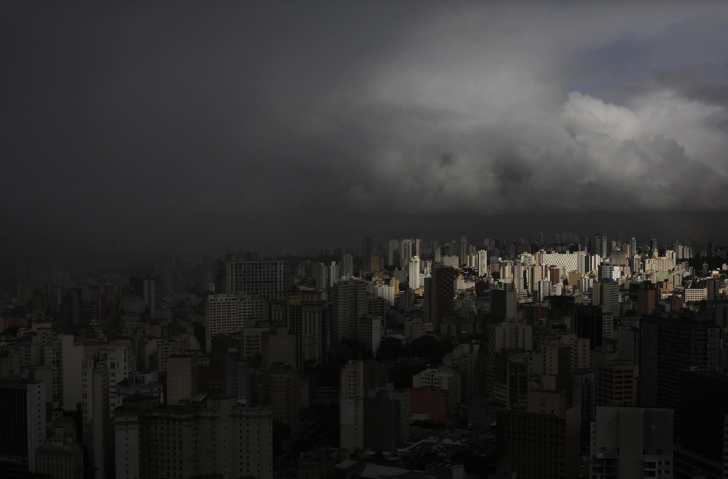Image: Rain clouds gather over the city of Sao Paulo