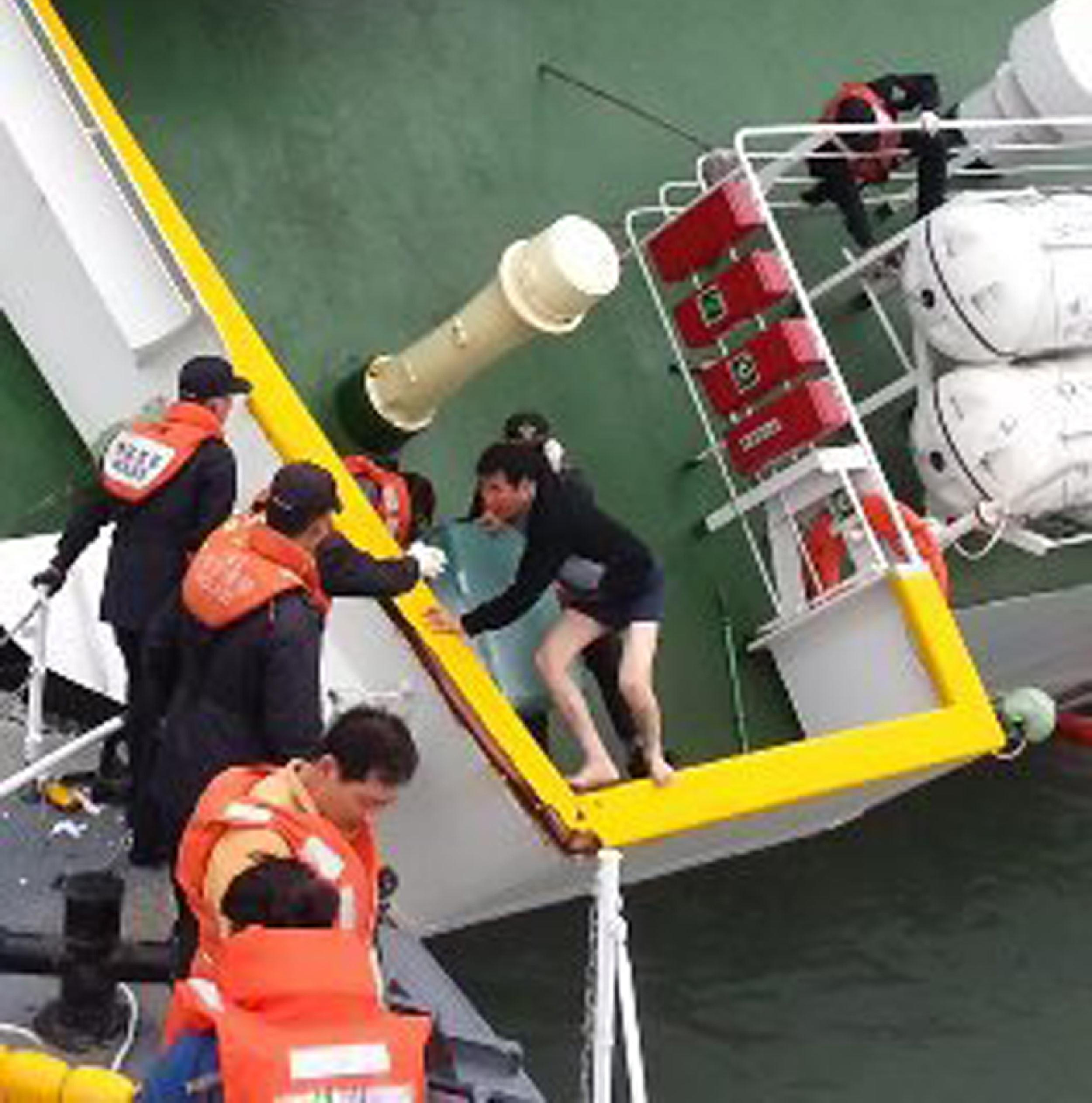 Image: Lee Joon-seok, the captain of the Sewol, fleeing from the sinking ferry