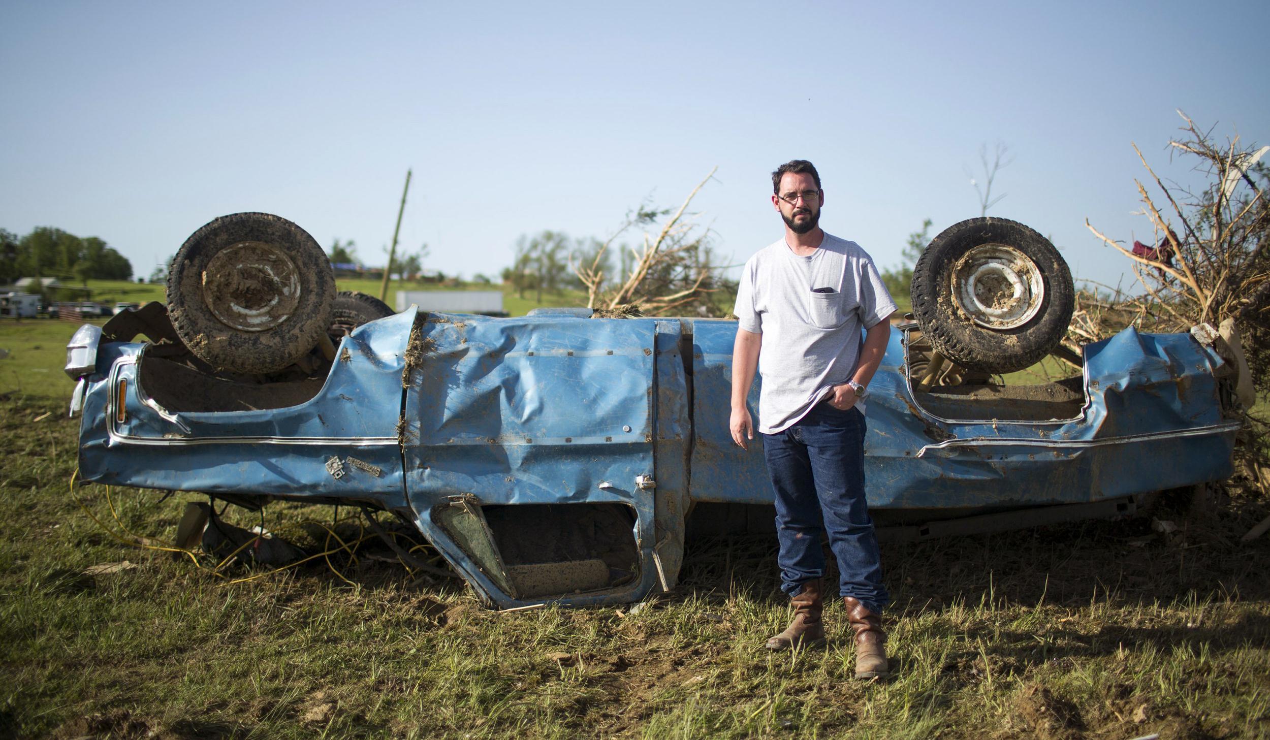 Image: Wade Lentz stands next to his wrecked 1980 Chevy Silverado in Vilonia, Ark.