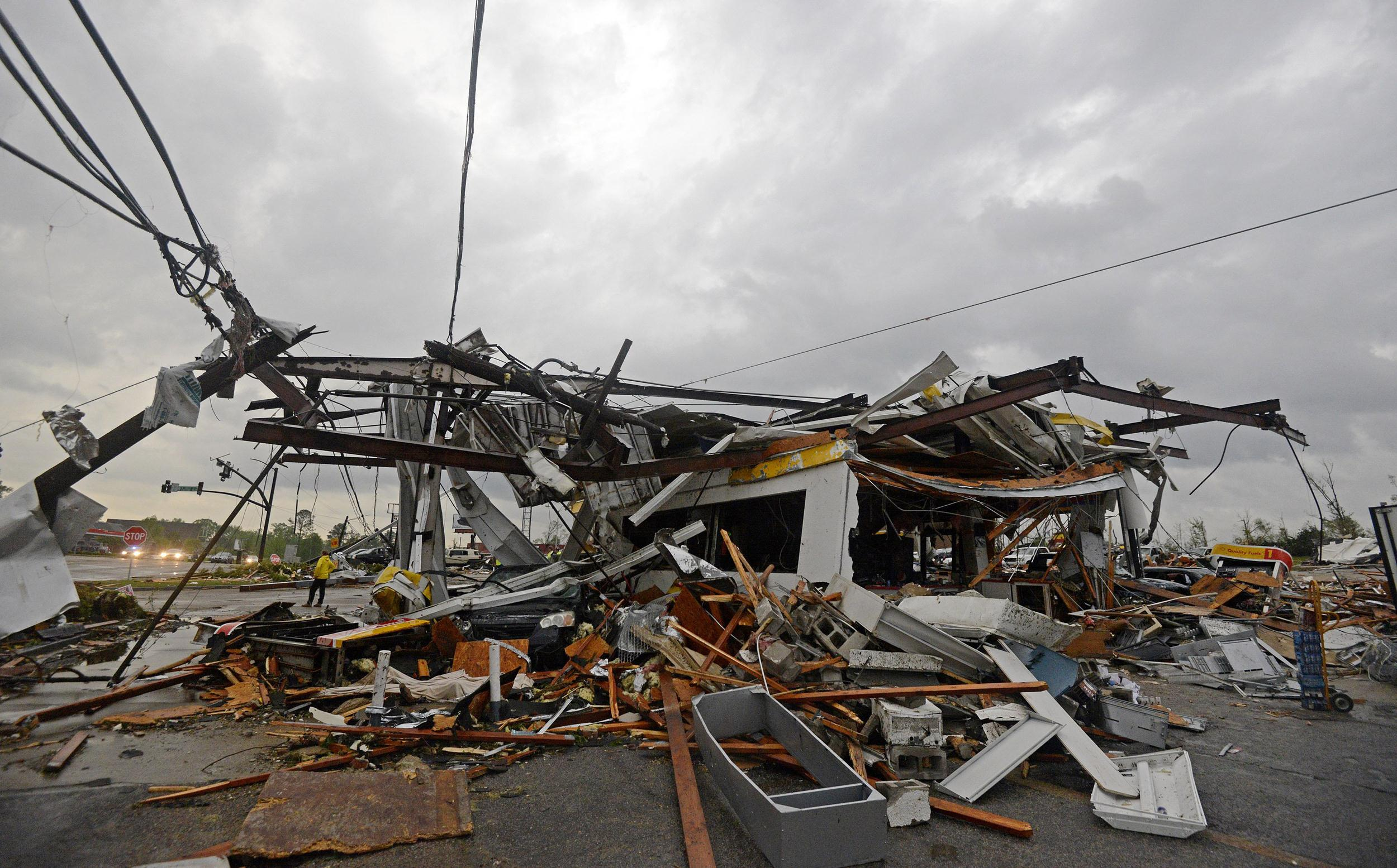 Image: Buildings are damaged along Gloucester Street after a tornado in Tupelo, Miss., on April 28.