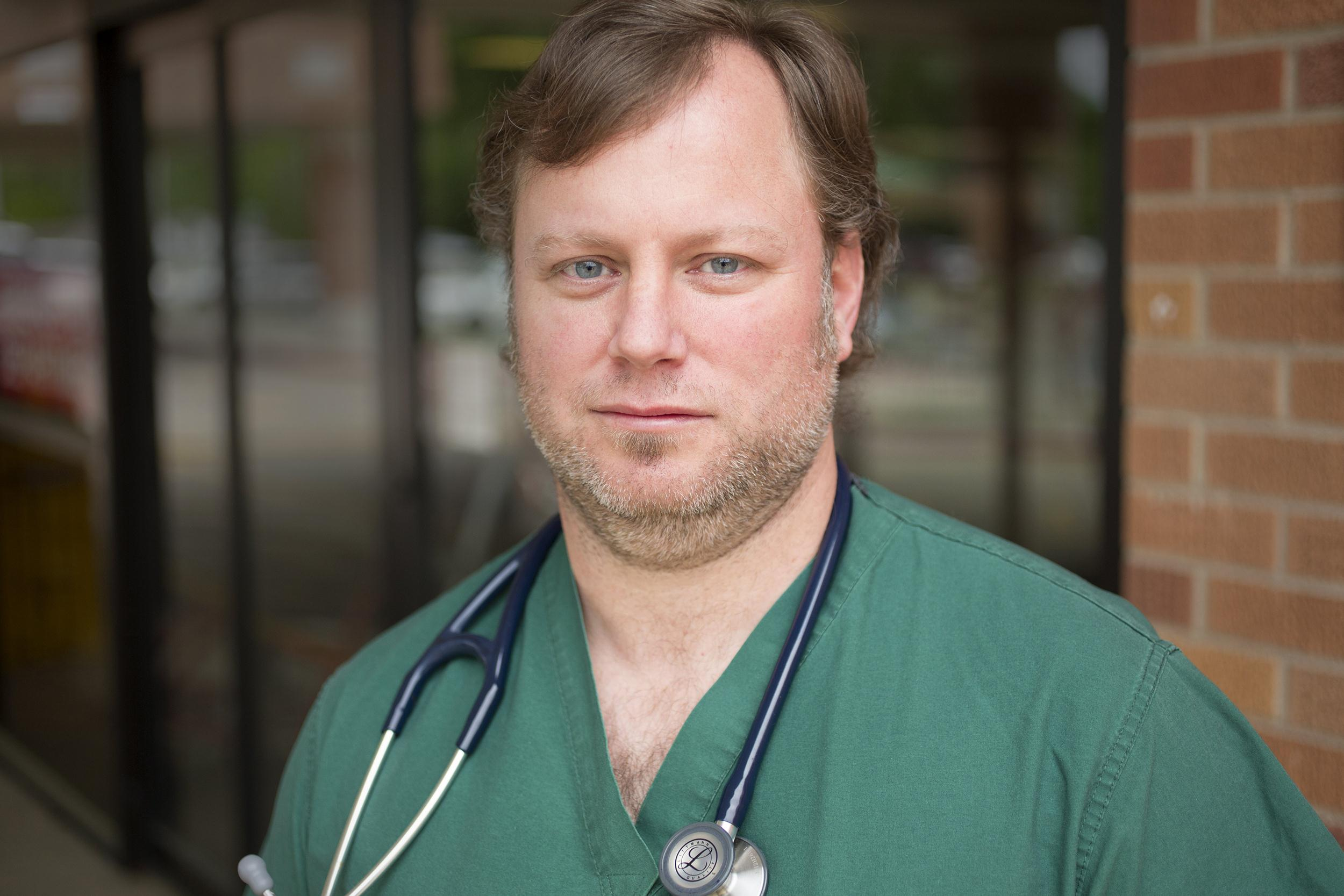 Image: Jason Skinner, an emergency room doctor at Conway Regional Medical Center, worked on Sunday night when a tornado swept through the regio