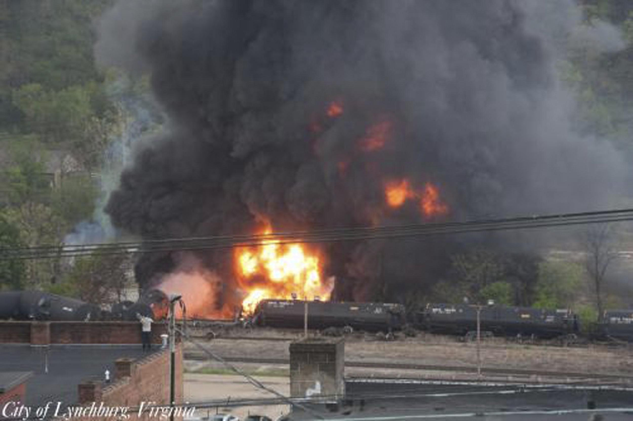 Image: Handout of flames and a large plume of black smoke are shown after a train derailment in Lynchburg, Virginia