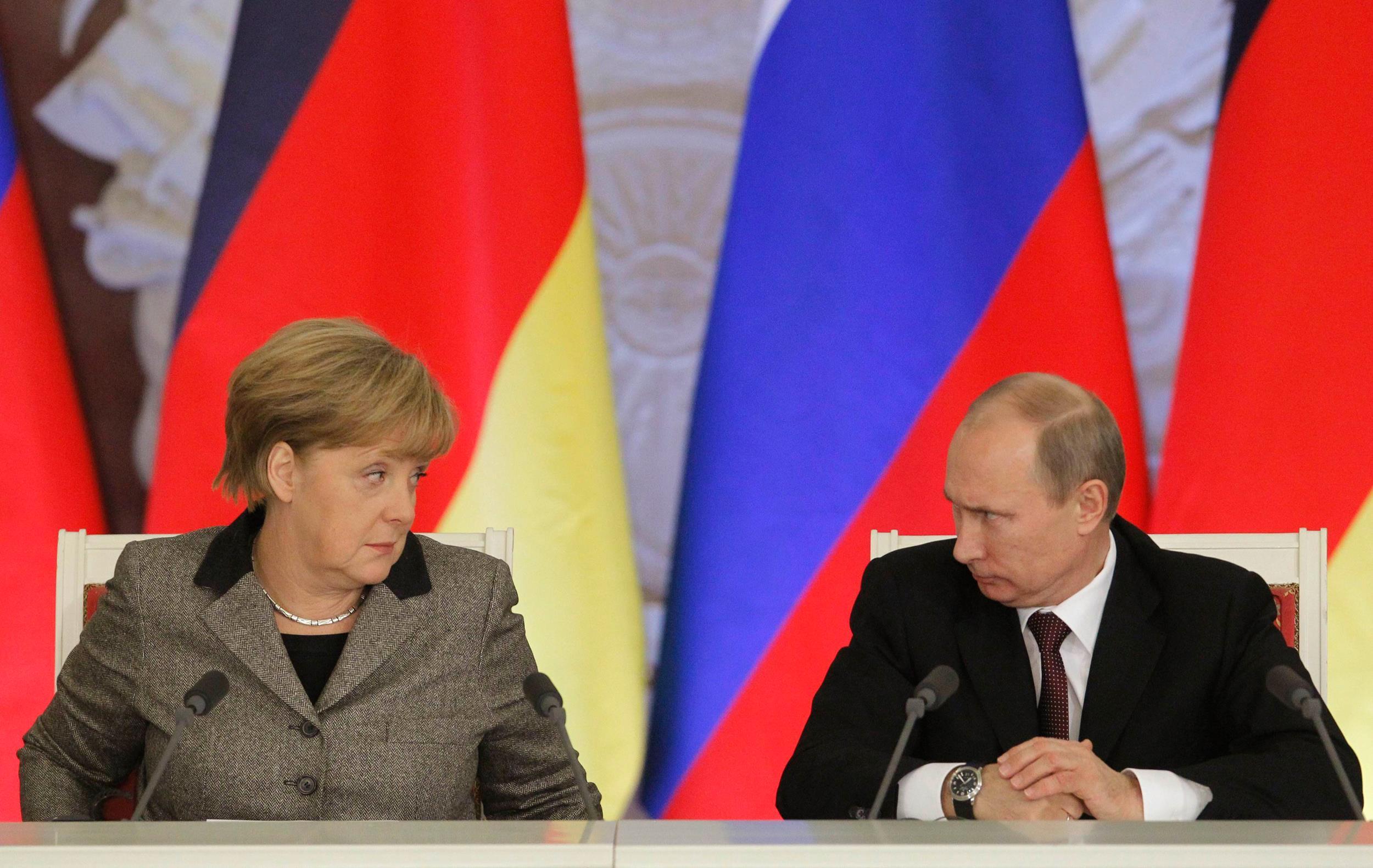 Image: German Chancellor Angela Merkel and Russian President Vladimir Putin