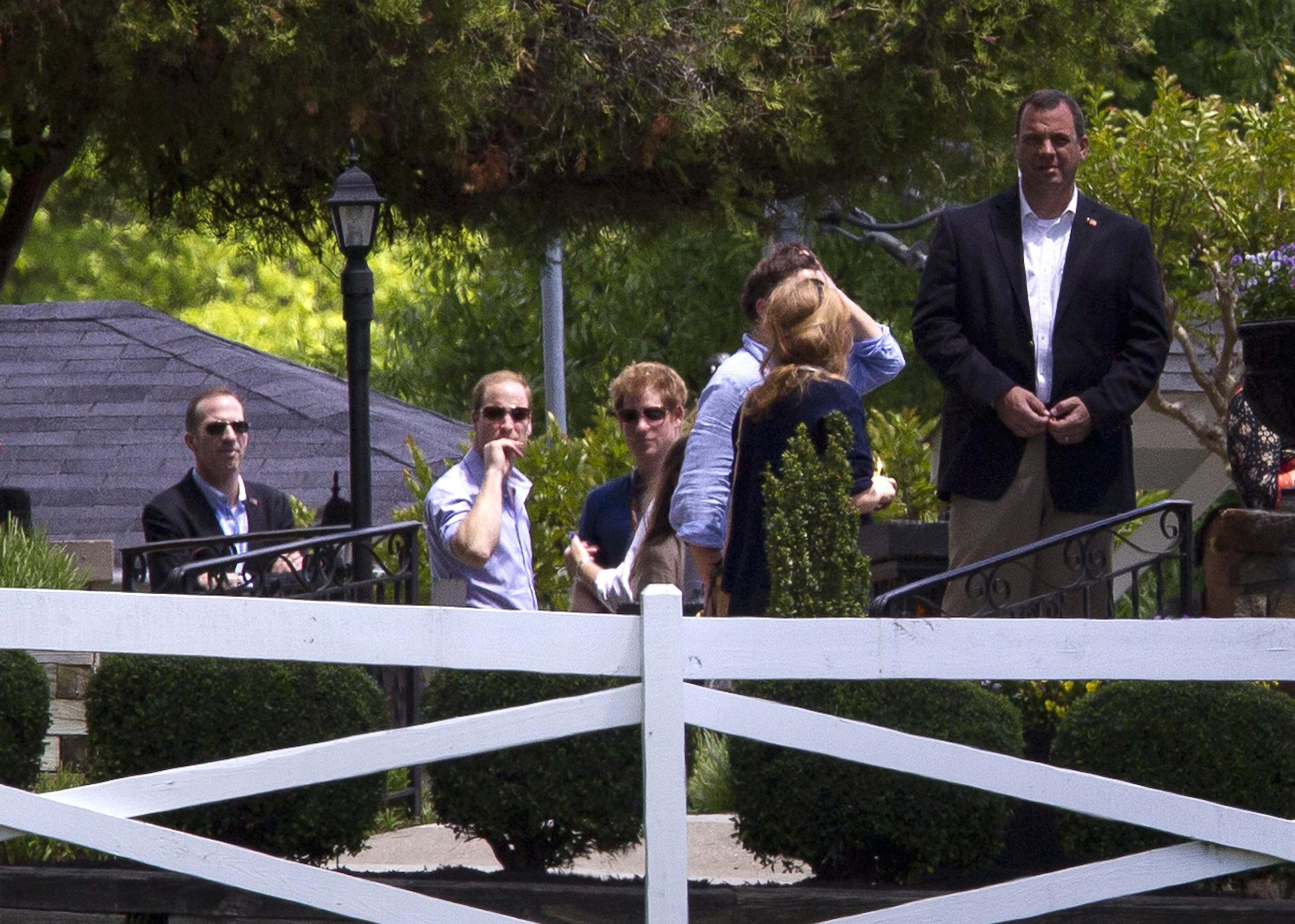 Image: British princes William and Harry arrive at Elvis Presley's Graceland in Memphis
