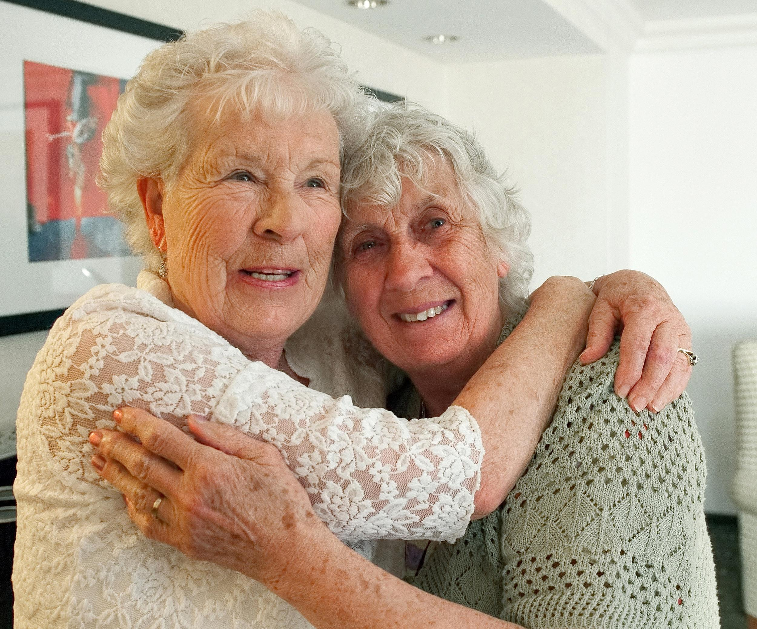 Image: Twin sisters, Ann Hunt, left, both 78, reunite for the first time since 1936,