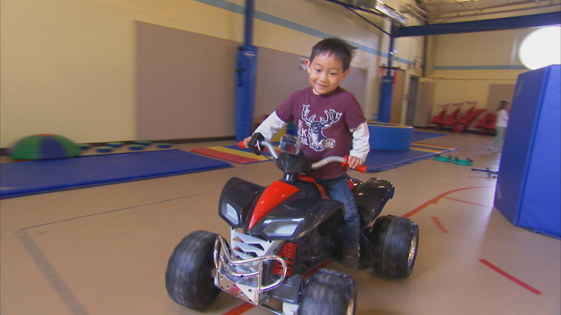 A program at the University of Delaware creates custom cars for disabled children to help them get around — and maybe walk again.