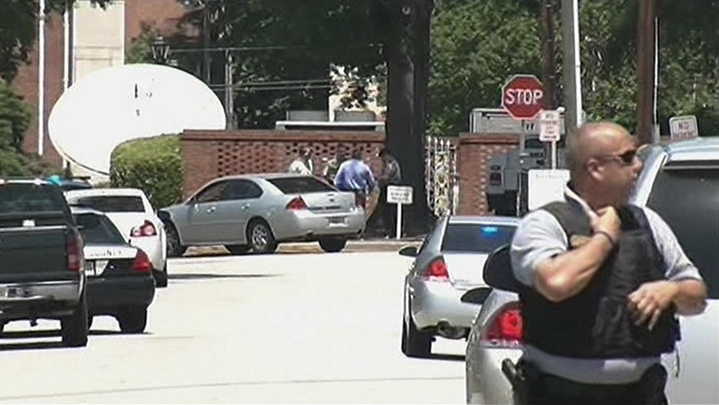 Image: Police stand near Paine College in Augusta, Ga., Monday.