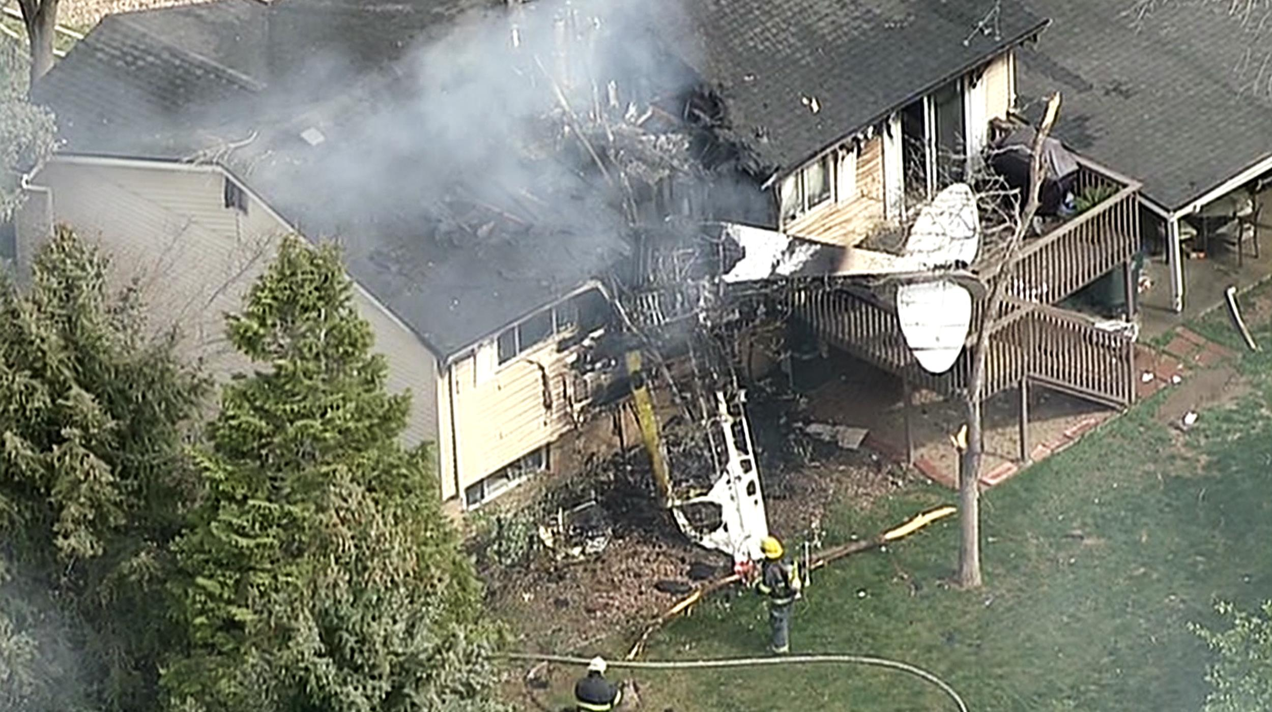 Image: A plane crashed into a house in Northglenn, Colo., Monday afternoon. Northglenn is a suburb of Dnever.