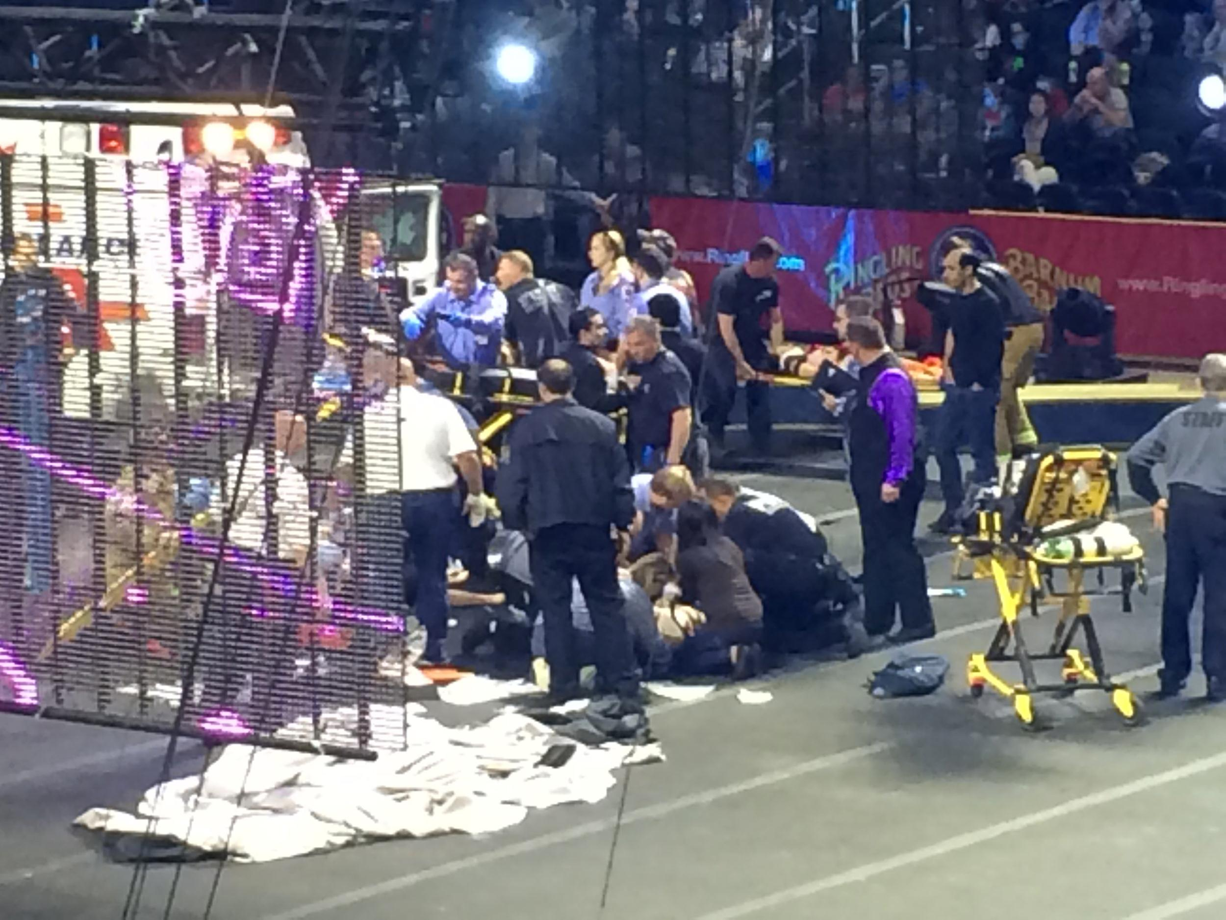 Image: First responders aid acrobats who fell during a routine.