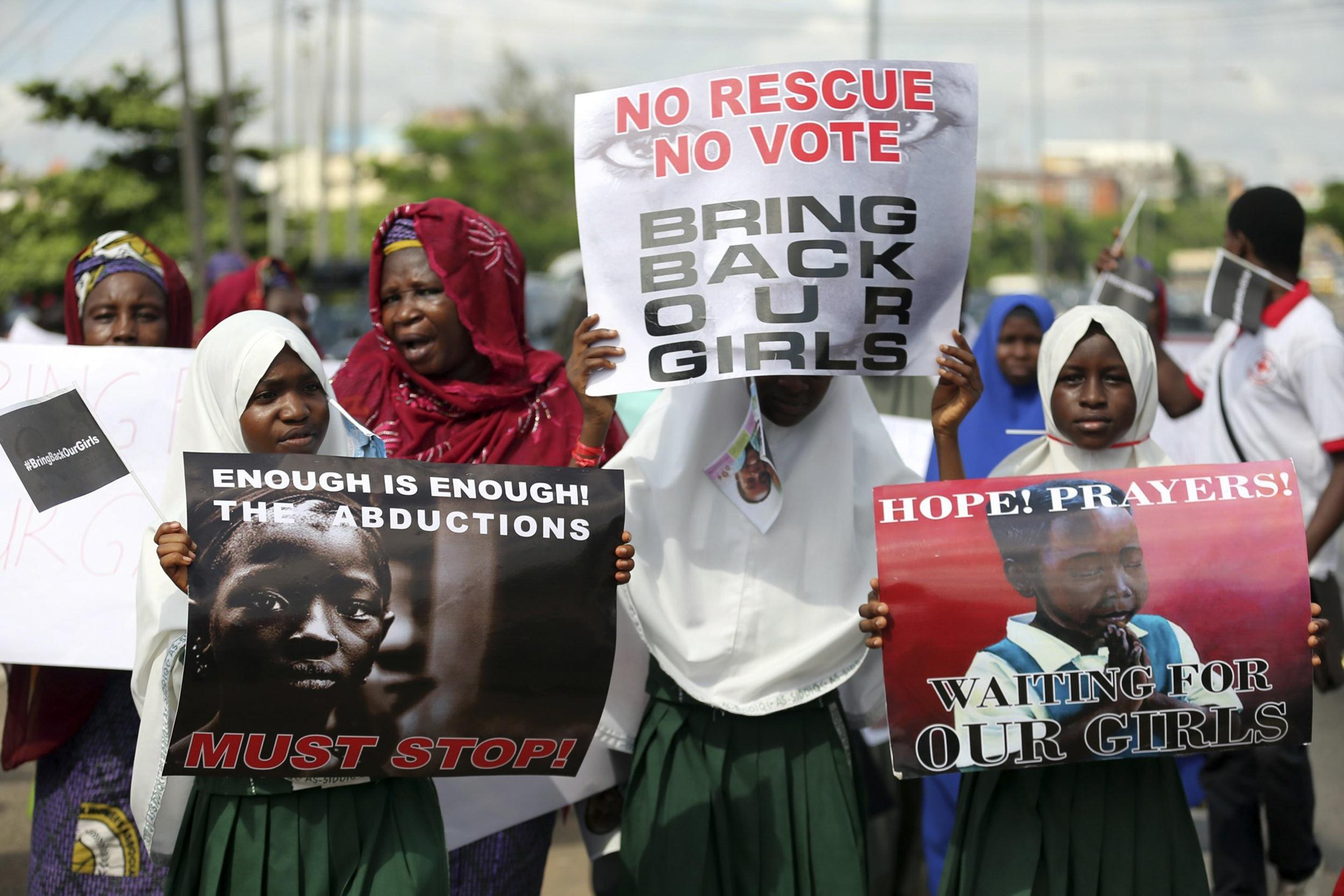 Image: Schoolgirls take part in a protest demanding the release of abducted secondary school girls from the remote village of Chibok, in Lagos