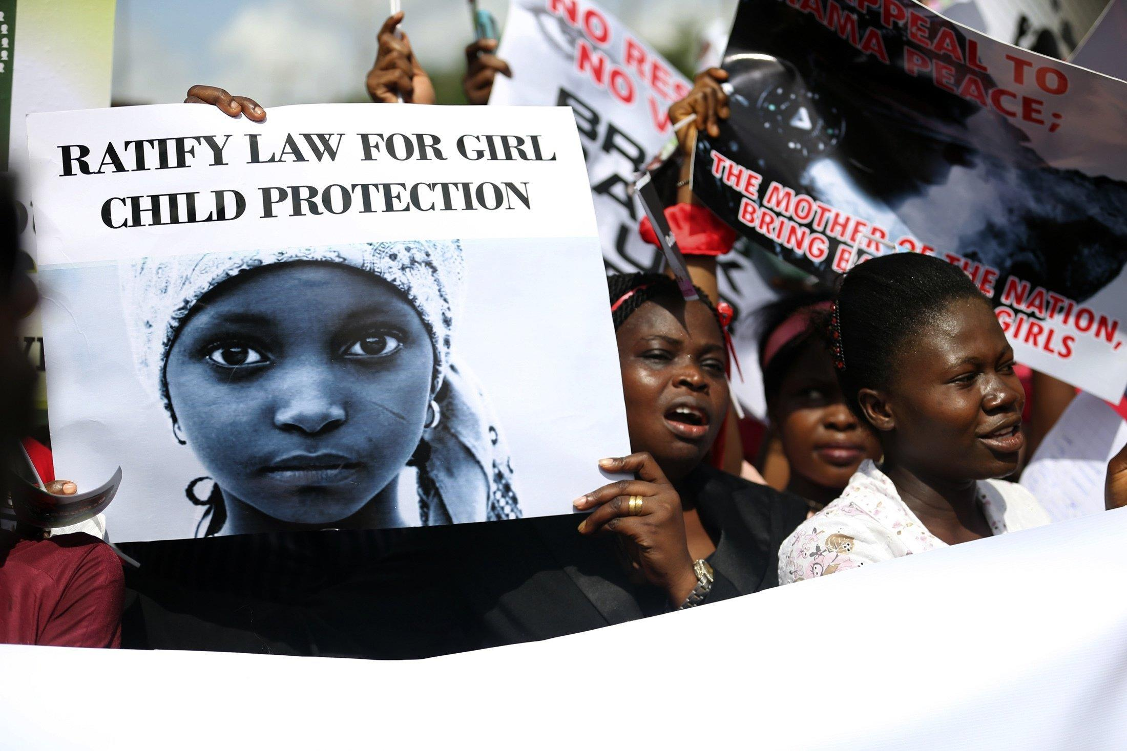 Image: Woman take part in a protest demanding the release of abducted secondary school girls from the remote village of Chibok, in Lagos