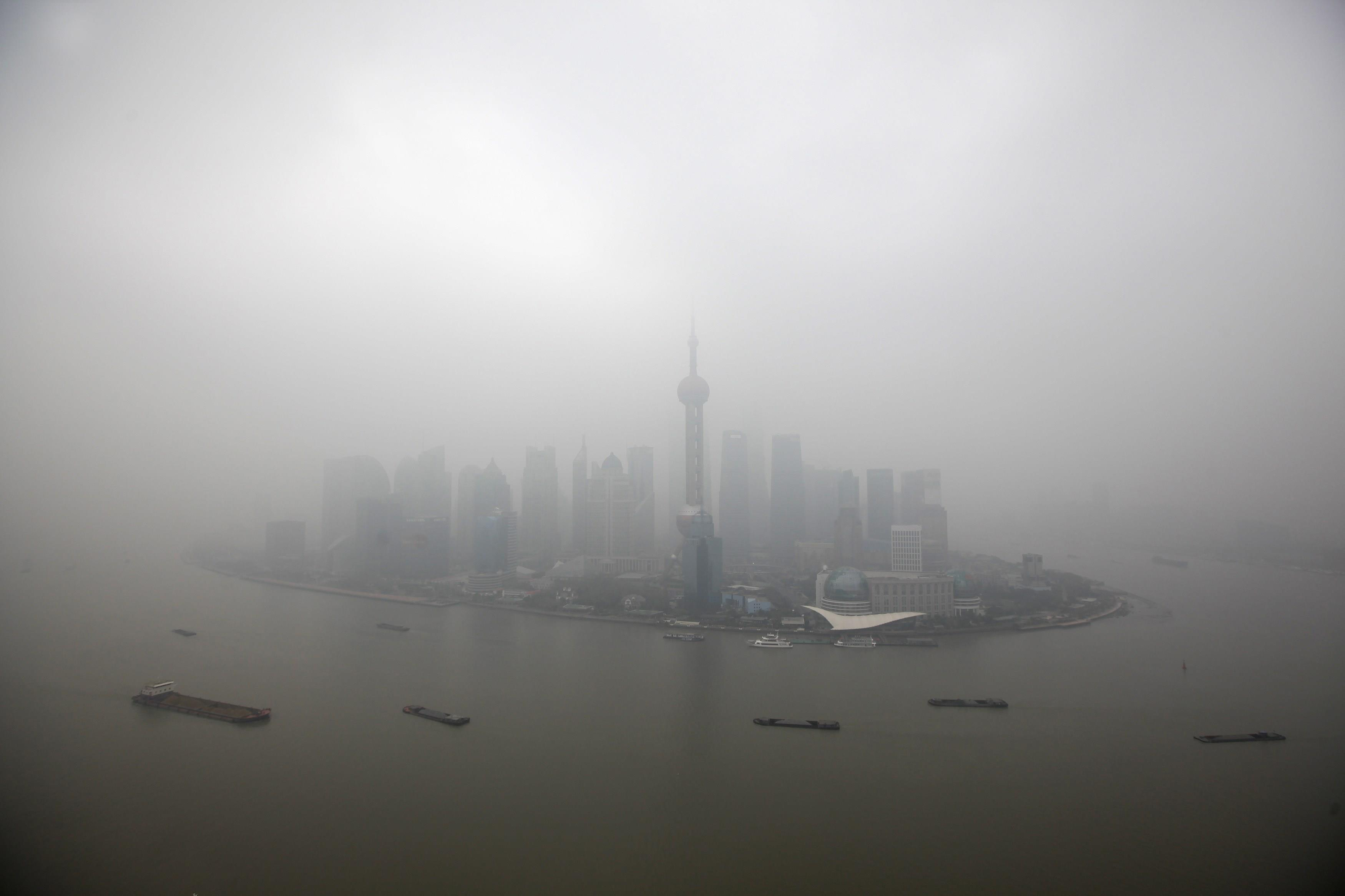 File picture shows the financial district of Pudong on a hazy day in Shanghai