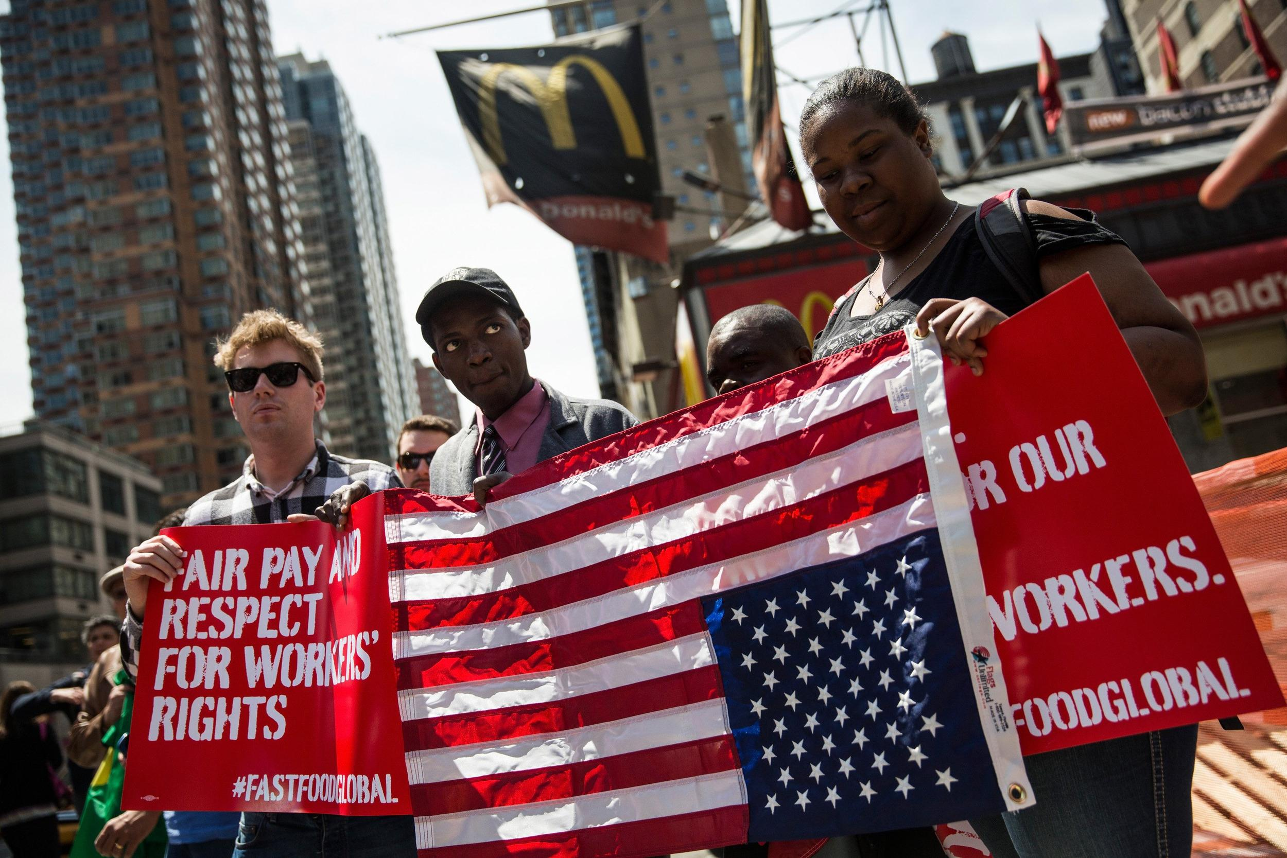 Image: Fast Food Workers Rally And Urge International Workers To Get Involved In Higher Wage Movement