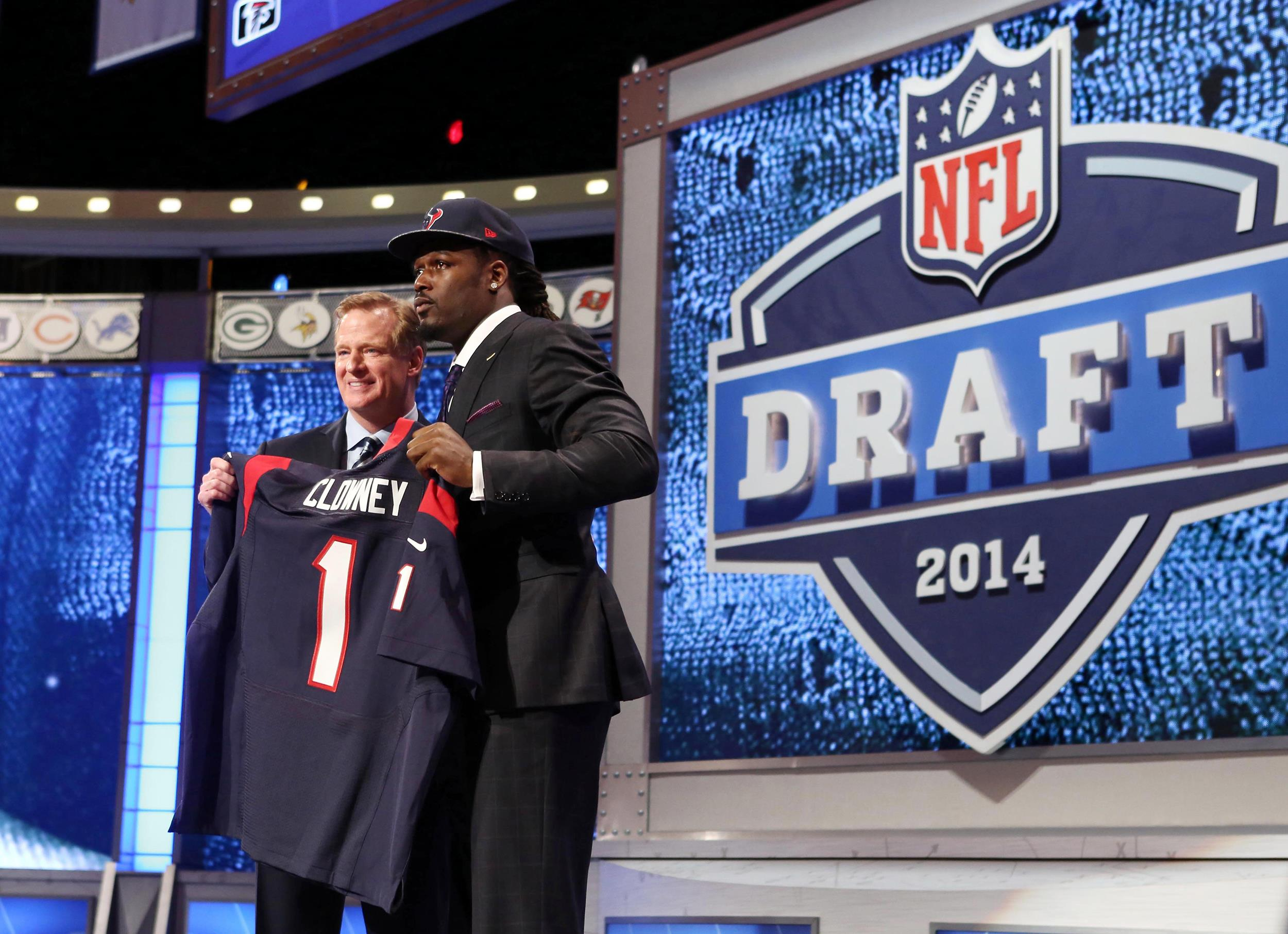 Image: Jadeveon Clowney poses with commissioner Roger Goodell after being selected as the number one overall pick in the first round of the 2014 NFL Draft