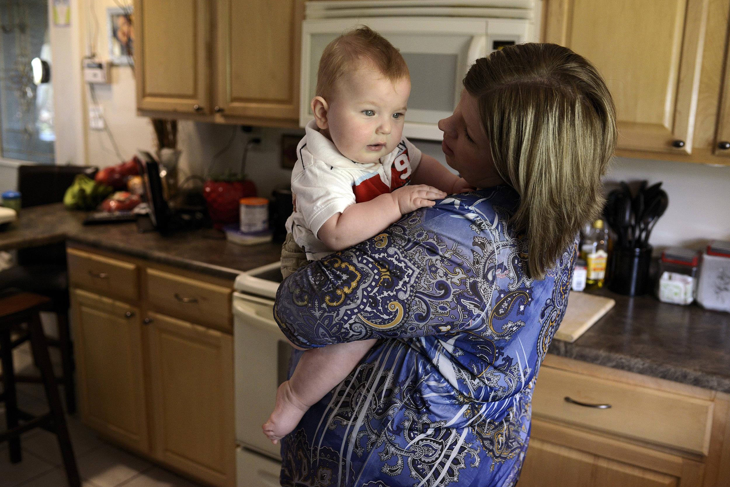 Image: Jenessa Moman holds her son Landyn Rich, 9 months