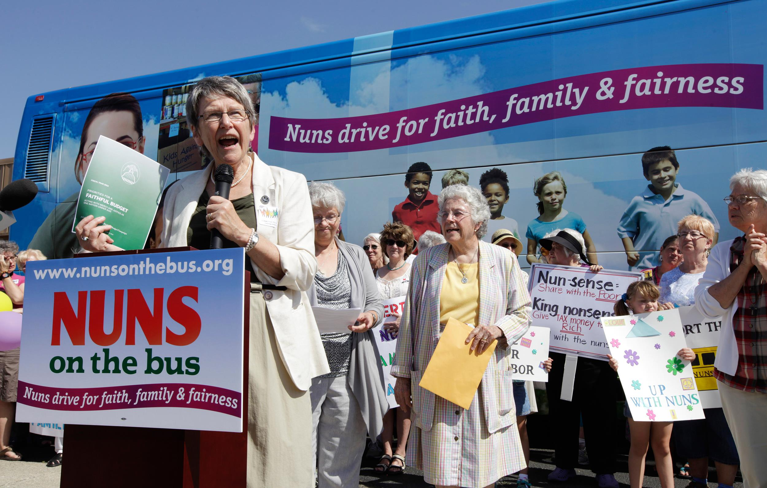 Image: Sister Simone Campbell, executive director of Network, speaks during a stop on the first day of a 9-state Nuns on the Bus tour