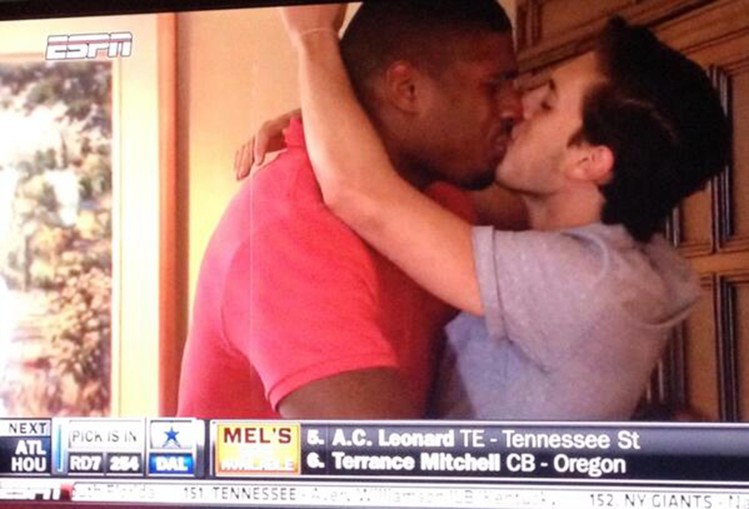 Image: Michael Sam kisses his boyfriend in celebration after finding out he has been drafted by the St. Louis Rams