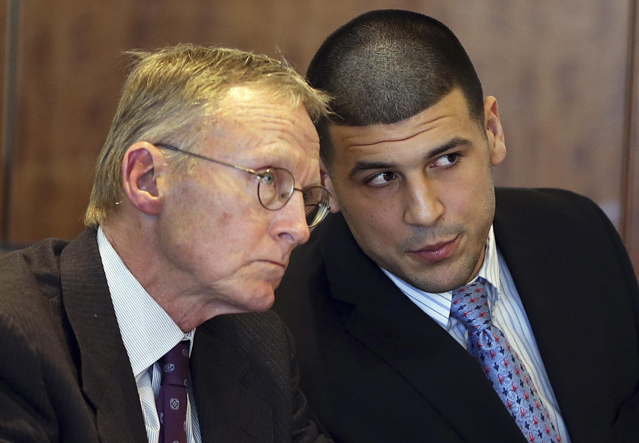 Image: Aaron Hernandez chats with his lawyer Charles Rankin as he appears for a pre-trial hearing at Bristol County Superior Court in Fall River