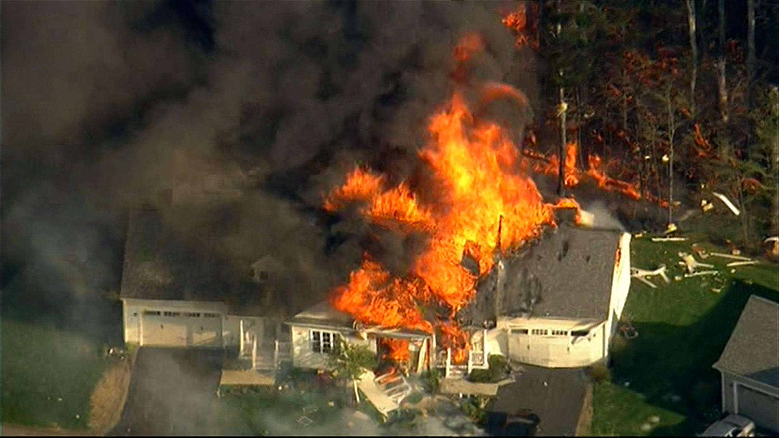 Image: The scene of a police involved shooting in Brentwood, N.H. where a house has exploded on Mill Pond Road