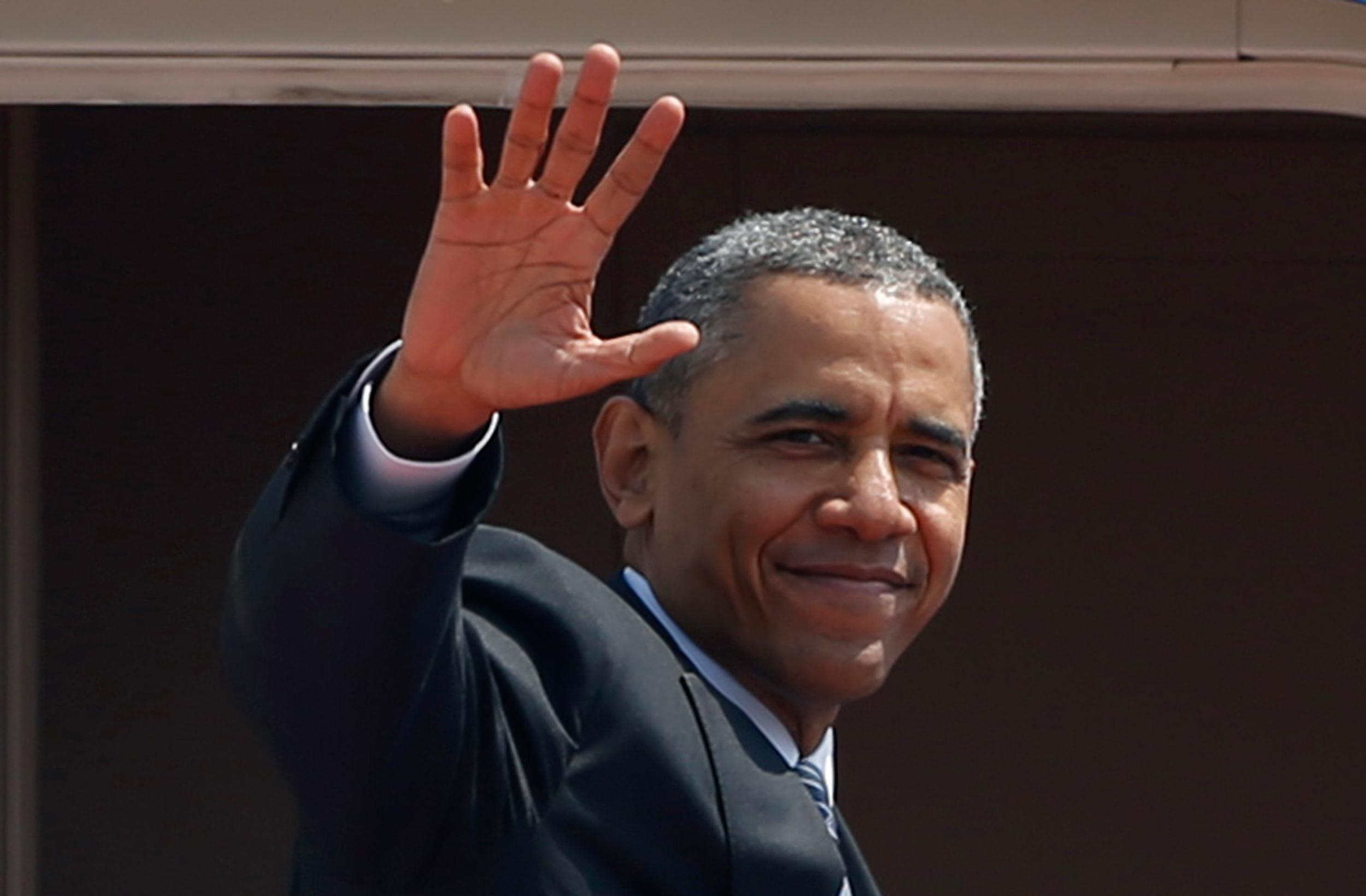 Image: President Obama waves from Air Force One as he departs Haneda International Airport in Tokyo