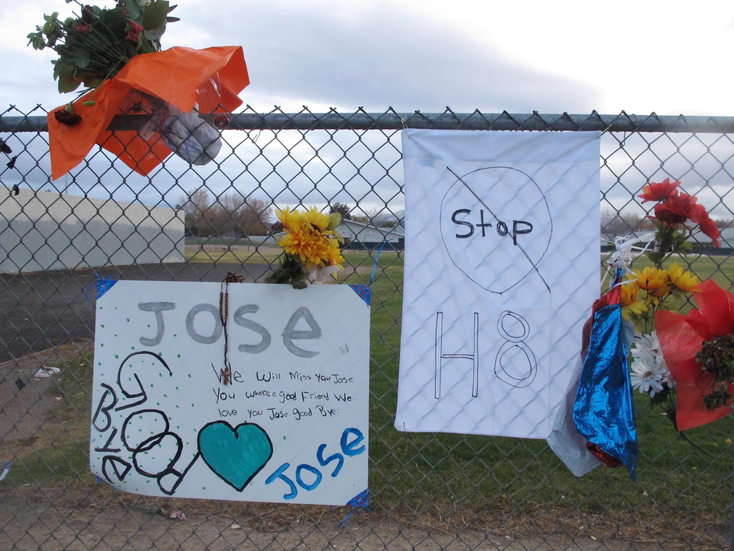 Image: Friends have added a message to Jose Reyes and a small wooden cross at a memorial