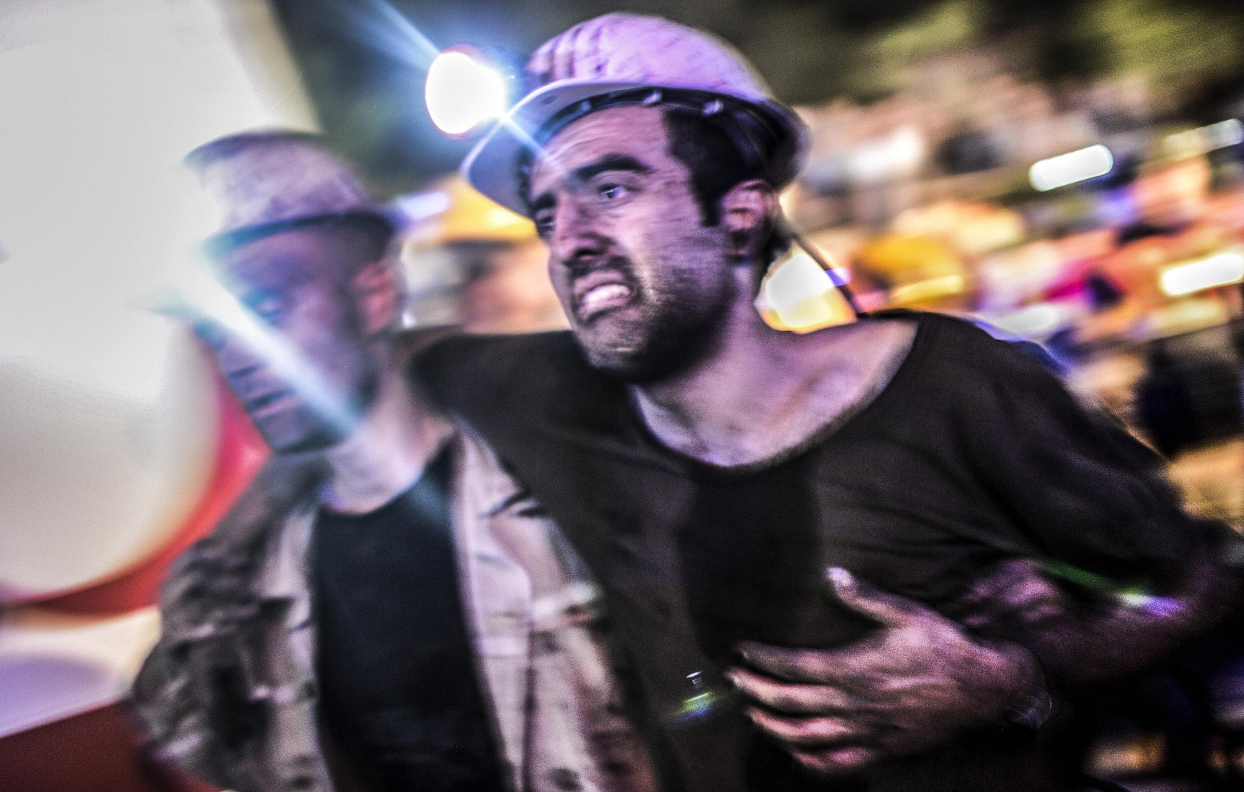 Image: An injured miner is helped by rescuers on May 13, 2014 after an explosion in a coal mine in Manisa, Turkey.