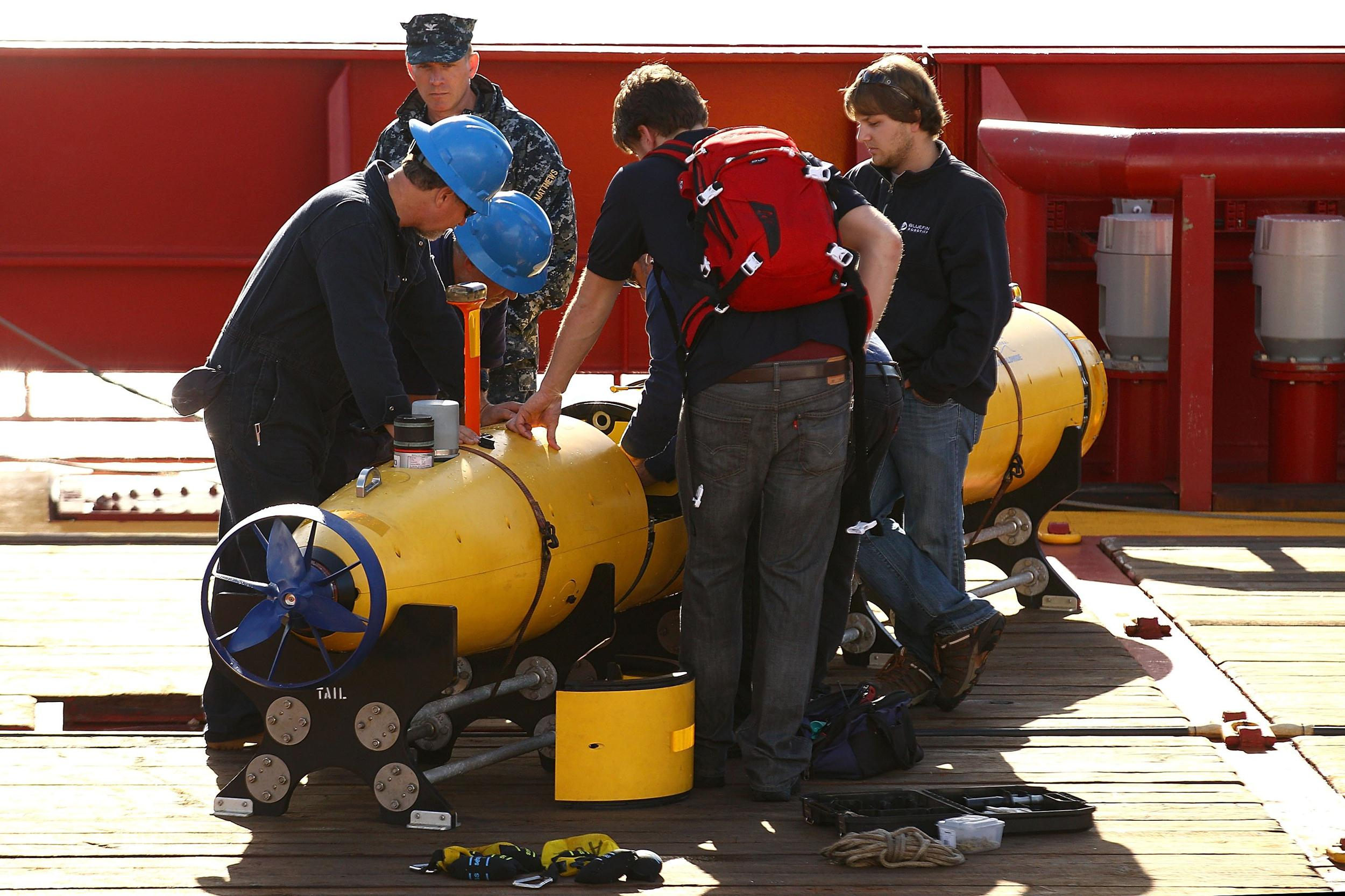 Image: Technicians work on the Bluefin-21 autonomous underwater vehicle