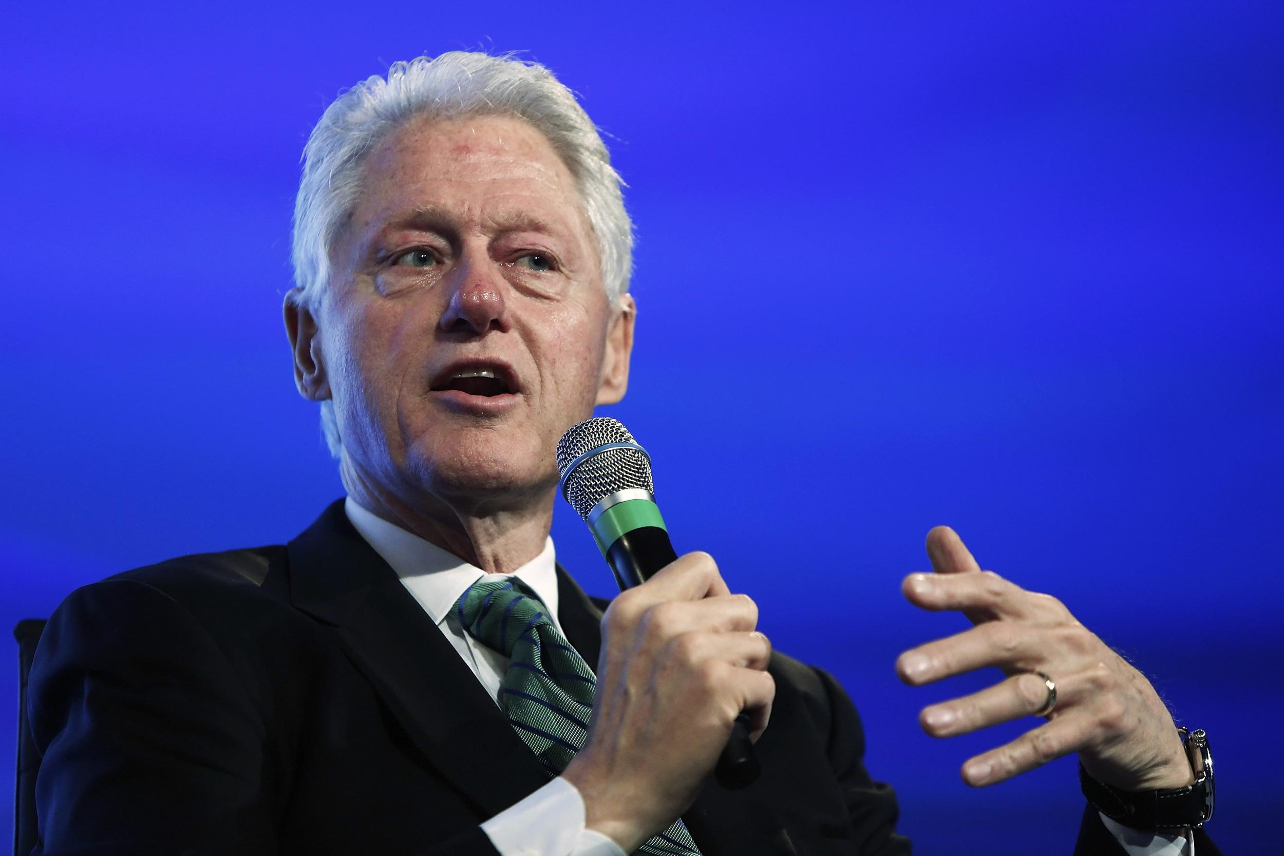 Image: Former U.S. President Clinton speaks during an onstage interview during the 2014 Peterson Foundation Fiscal Summit in Washington