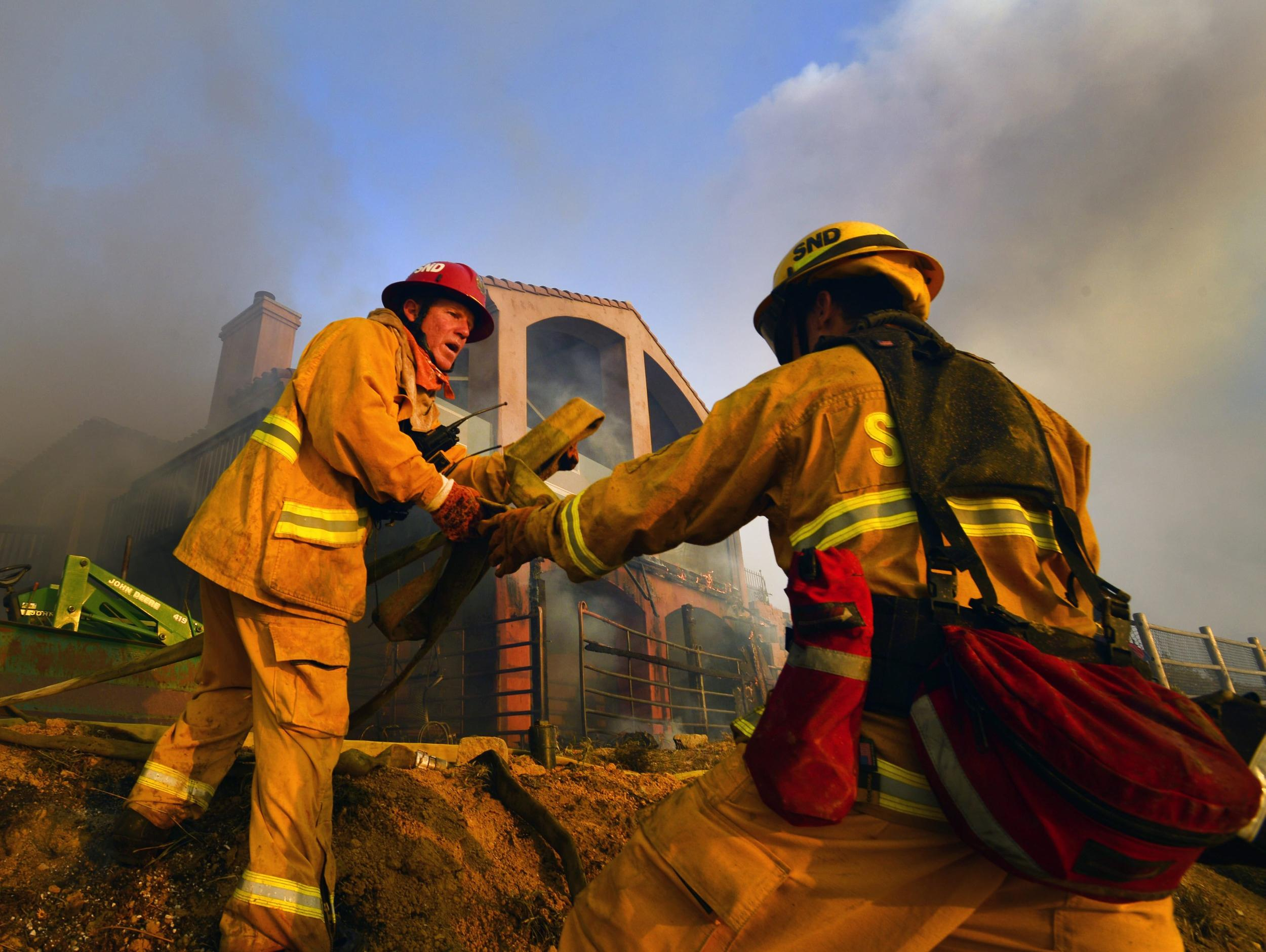 Image: Firefighters in San Marcos, California, on Wednesday