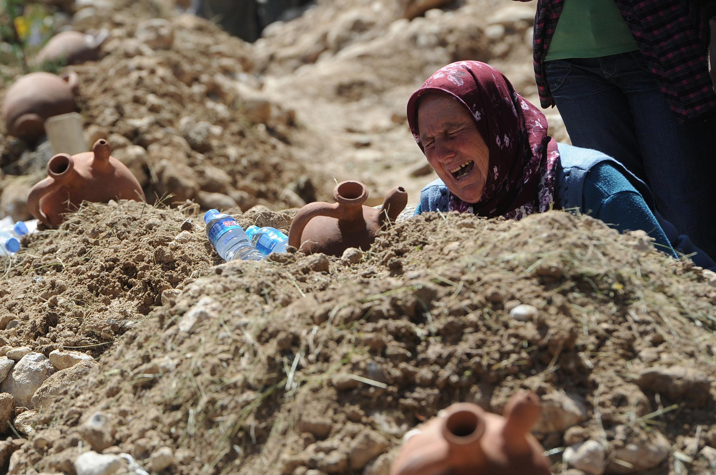 Image: A woman cries at the grave of a mine accident victim in Soma, Turkey, Thursday, May 15, 2014.